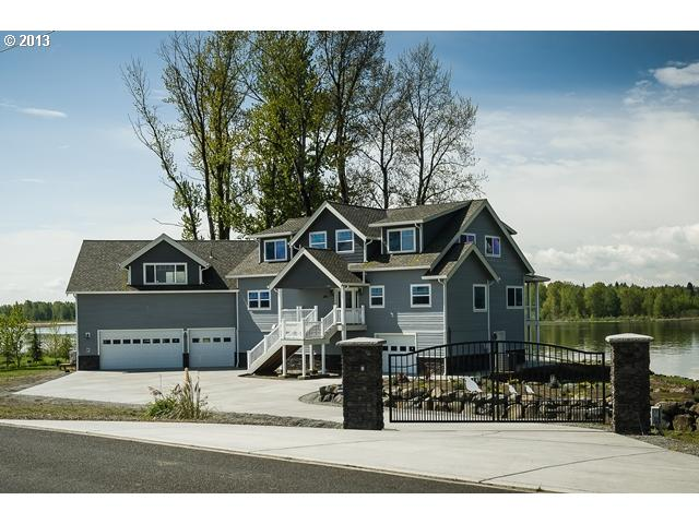 Your very own private beach property! This 6,125 SF home sits on over 130 feet of Columbia Riverfront with views of Mt. Hood, Mt. Saint Helens or the Majestic Columbia River from every room!