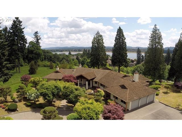 A must see beautiful, custom, daylight ranch home with expansive Columbia River and city light views.