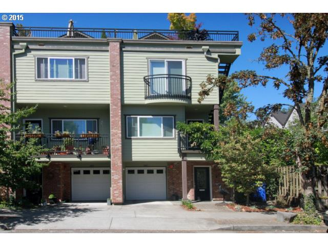 End unit and 4 stry townhouse with rooftop deck in great location-Walk to shops-cafes on NW 23rd-Chapman.  Lots of windows-Sunny & Bright-Energy efficient - Gas frplce- Main floor deck overlooks park-cherry floors on main floor, kit w/granite counters, high end appliances+ big pantry. 3 rooms & 2.5 bths-full third floor w/large rooftop deck with views. Even has landscaped side yard with a private shady patio- Tandem garage. No HOA fees.