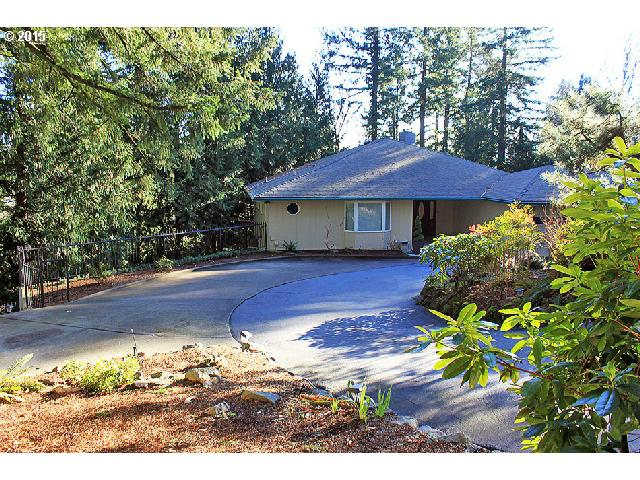 Beautifully remodeled home-like a tree house! Spectacular huge open living room-Floor to ceiling walls of windows looking out on bright forest below-Gas fireplace+ Dining w/wood floor. Kitchen is gorgeous-High quality cabinets-Granite-Maple floor-Bright covered deck-Gas range! Huge Master suite w/den-could be bedroom! Family room is like living room-Huge-Spectacular windows-Fireplace! Bonus wired/plumbed 2nd kitchen. Lower Basement-shop