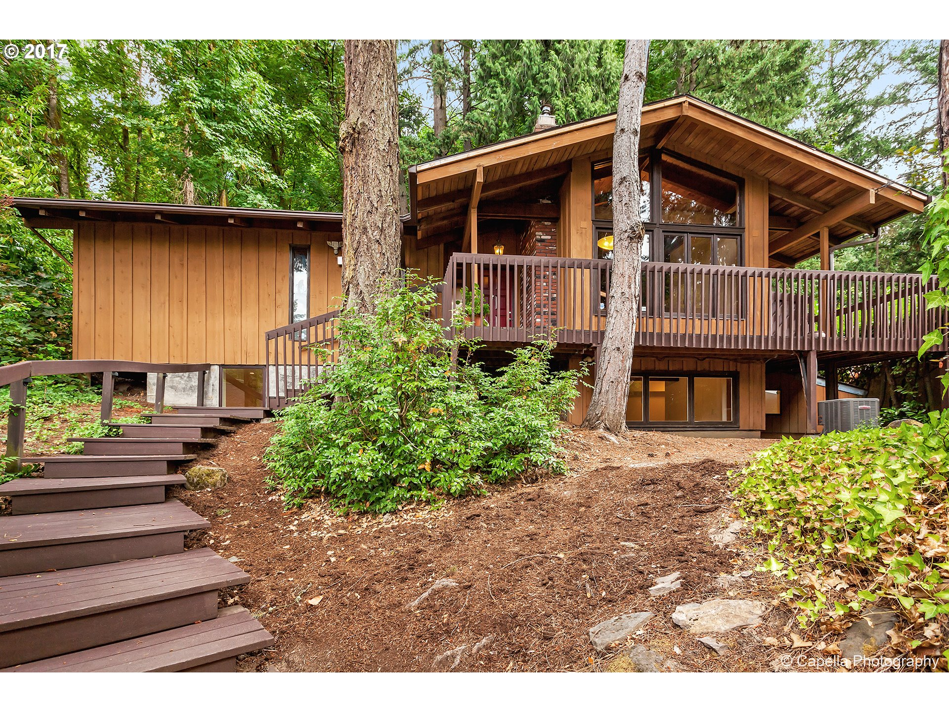 OPEN HOUSES: SAT/SUN SEPT 23RD/24TH FROM 12-3PM. Don't miss this Mid Century Modern home in park-like setting nestled in the trees but..only a 10 minute drive to downtown Portland, Intel or Nike. Unique architecture w/ exposed vaulted beams, box-beam ceilings & Skylights. This renovated home has NEW: roof, AC, tile floors, carpet, granite bathrooms counters, electrical panel, 5-point wiring for sound, lighting, plumbing, & MORE. NO HOA!