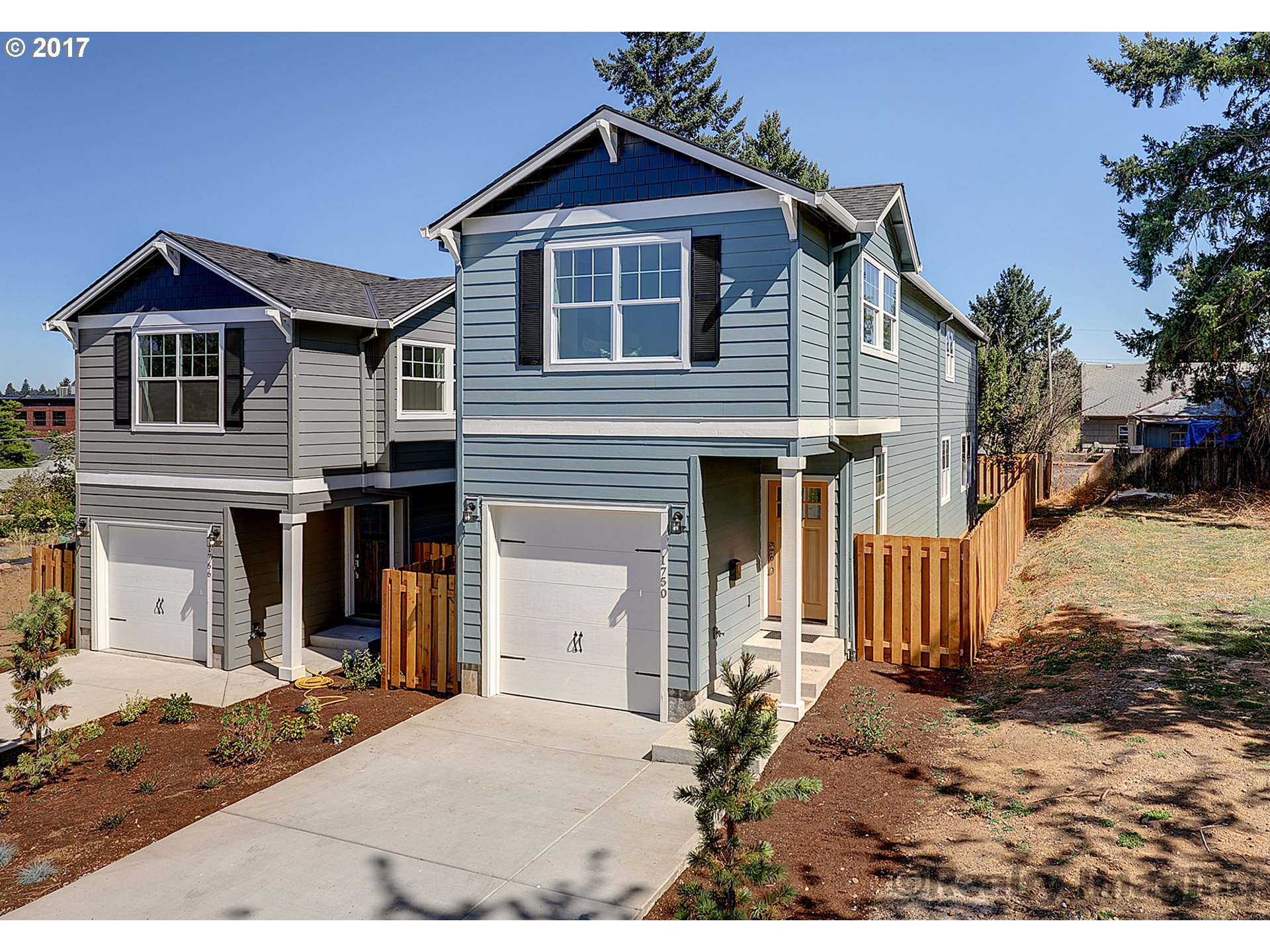 Brand new in Rose City Park! If you missed its twin next door (sold in 16 days) now is your chance! Smart flrpln w/4 bdrms & laundry up! Top shelf finishes! 9 ft ceil, cool fixtures & wood flrs; great rm concept; open fam rm/kit/dining! Gorgeous kitchen w/quartz & ss applcs; fam rm w/frplc & blt-ins; vaulted master suite; stunning tile work/lush baths; fenced yard w/patio! Walk/bike to park/golf course!