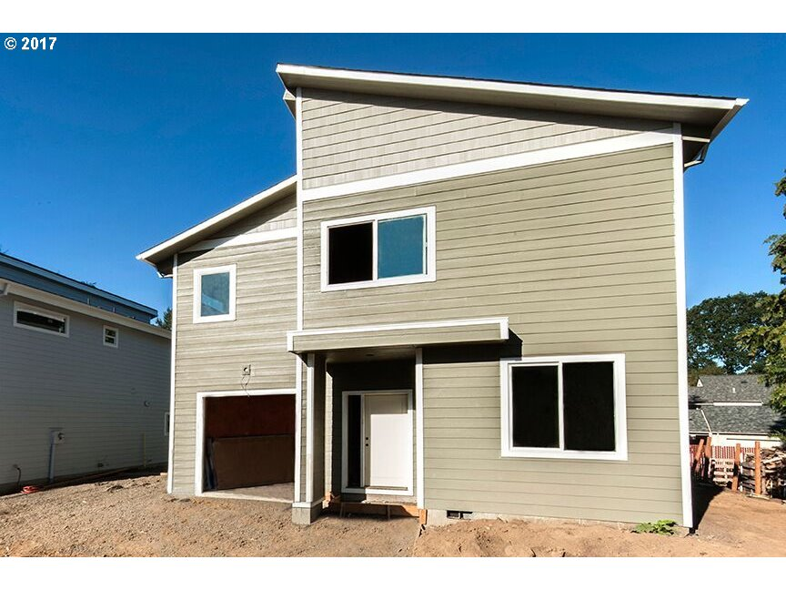 Excellent location with this contemporary new construction home close to parks, library, high school, and DT Beaverton. Great commute to Nike and Intel with EZ access to 217. Energy efficient, vaulted ceilings, hardwood floors, full landscaping, bath & bed on the main, must see! Opportunity to choose colors. Possible dual living. Buyer to verify schools.