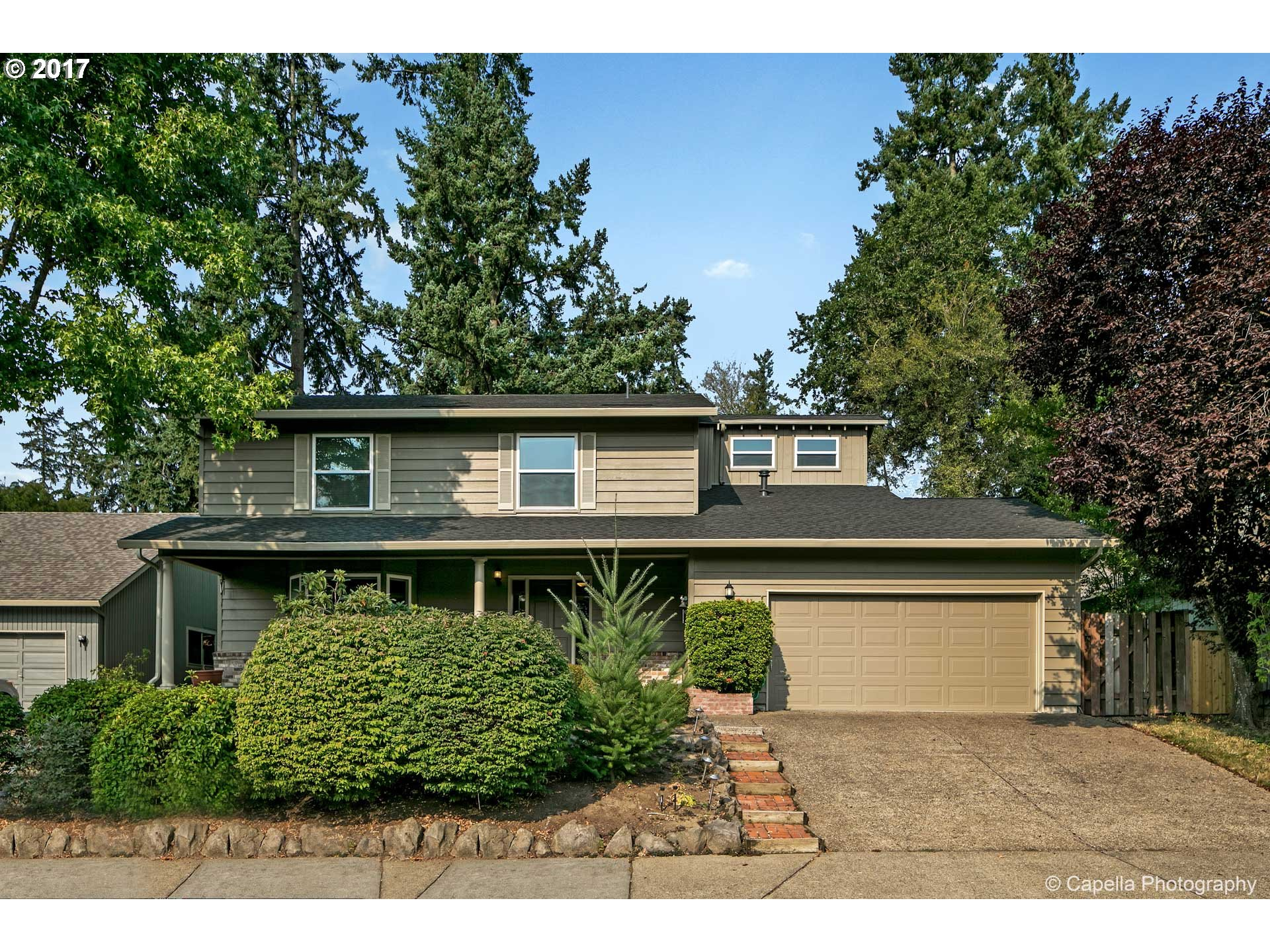 NEW PRICE. Spacious home on a cul-de-sac of Beaverton. Tip Top shape w/ Hardwood floors in entry, hall, half bath, kitchen, FR, Nook and Sunroom. All 5 bedrooms upstairs w/ many having walk-in closets. Master bathroom w/ claw foot tub &  tiled shower. 2017: Exterior painted as well as new interior doors & hardware, 2016: new windows, 2010: new furnace/AC, 2008: new water heater. Great backyard deck w/ built-in seating. NO HOA.