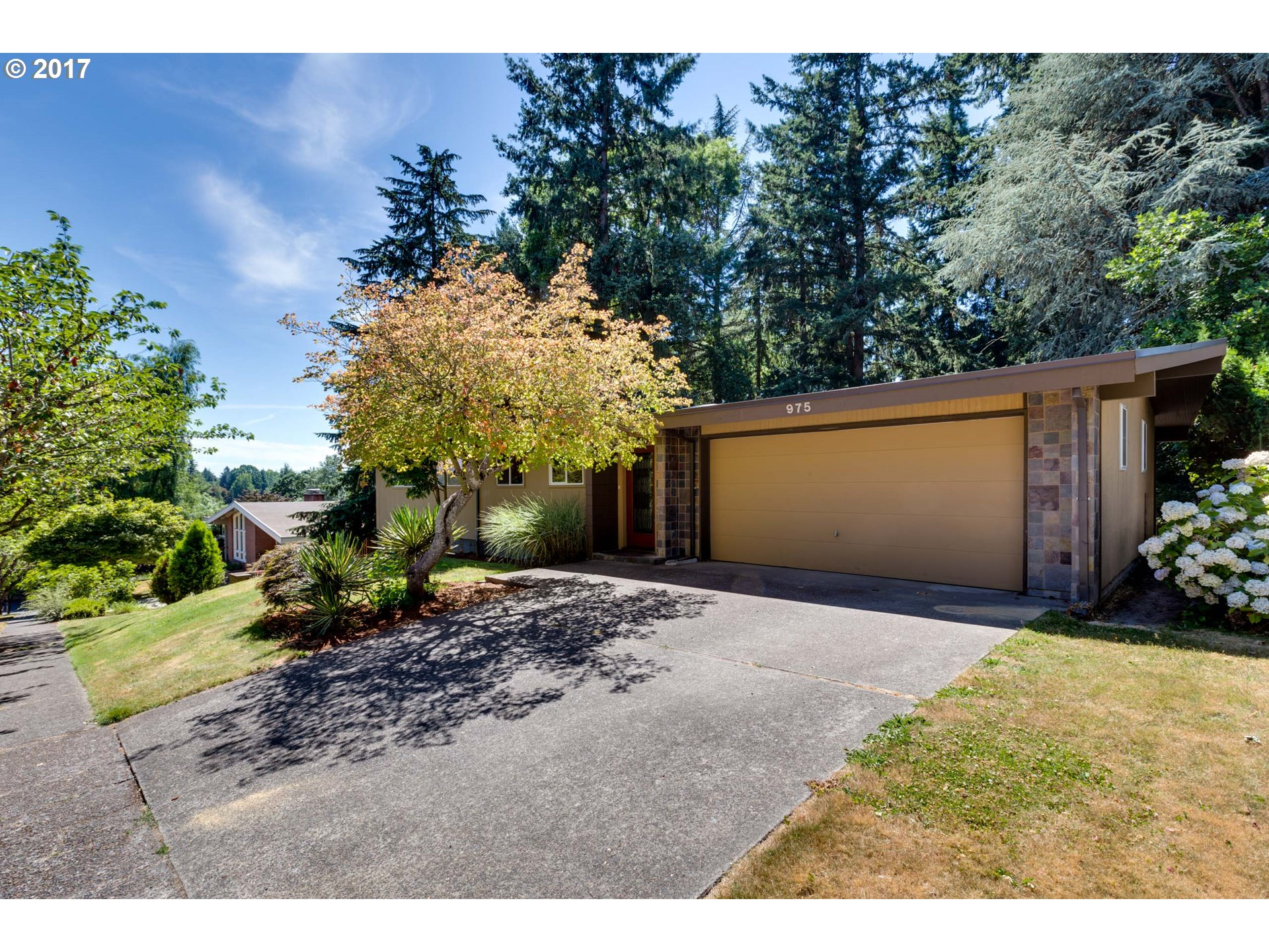 Exquisite Mid-century designed for privacy. Hardwood floor, vaulted ceilings, slate and carpet through-out. New carpet throughout. Perfect for entertaining. Easy access to Sunset hwy and downtown Portland. Room for pool table, wine bar, and media room is already wired.