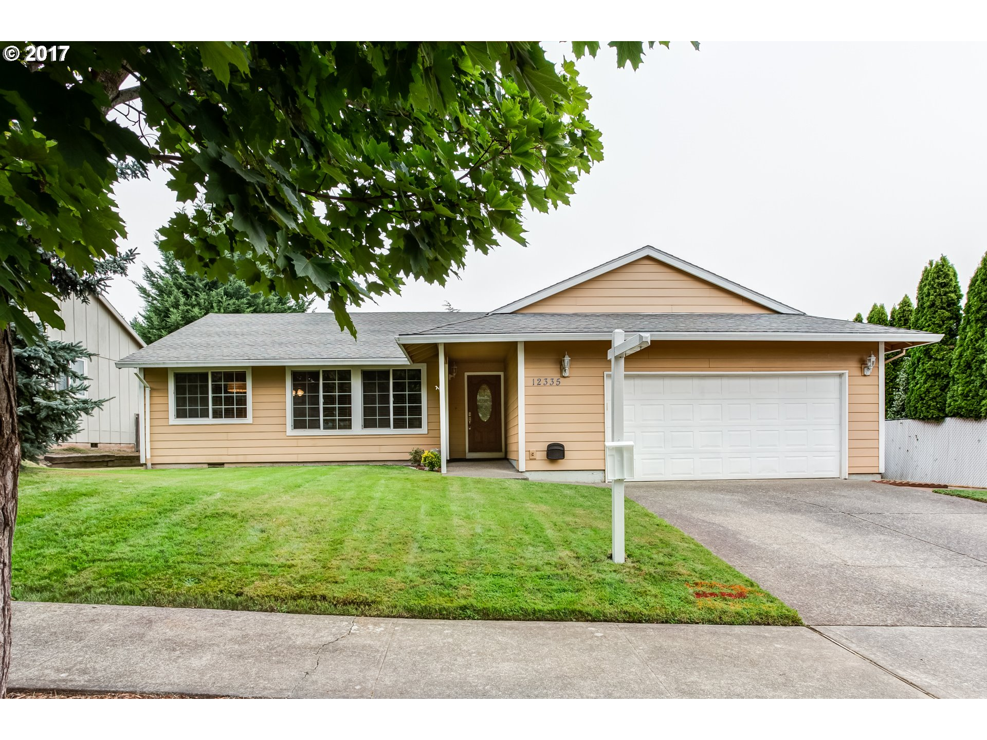 """This 70's Ranch is """"just right"""" with 1680 sq ft and a big yard! Vaulted ceilings, sunken living rm, family rm w/fireplace, kitchen w/new quartz counters & tile back-splash, pantry & eating area.  Lots of updates thru-out including interior doors, paint, light fixtures, main bath fixtures. Newer furnace, AC, electric panel & vinyl windows too! Backyard w/Patio for entertaining. Great Neighborhood near schools, shopping, & trails to park."""