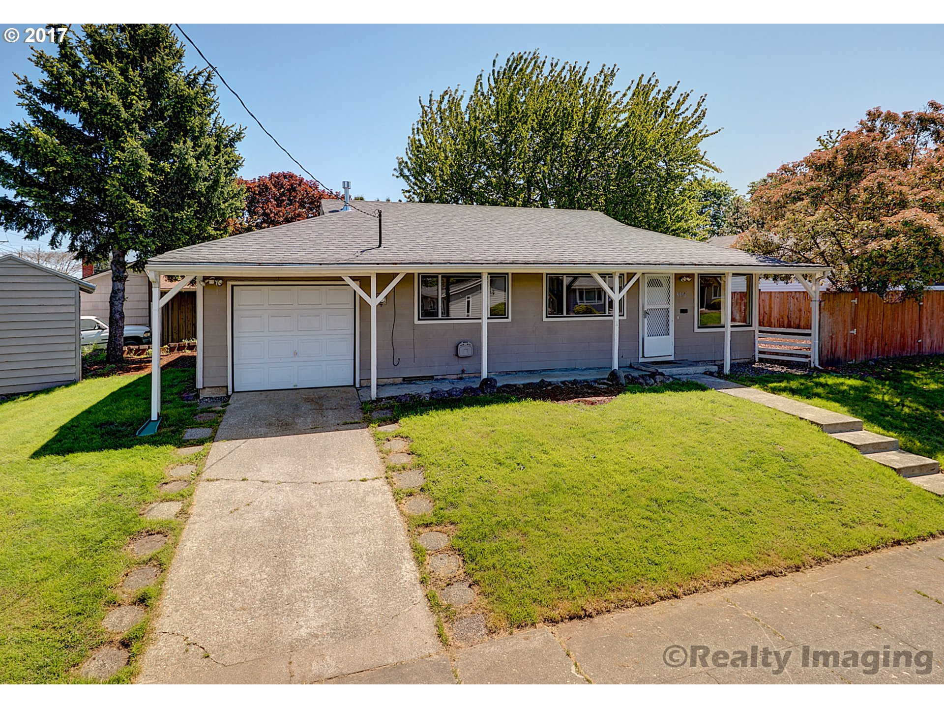Move into this one level home located on a corner lot just minutes to New Seasons & Starbucks. Brand new roof, furnace and hot water heater. New kitchen appliances. Remodeled bathroom.    Attached single car garage. Fully fenced back yard. Tool shed for additional storage. Just blocks away to the brand new Roosevelt High School!