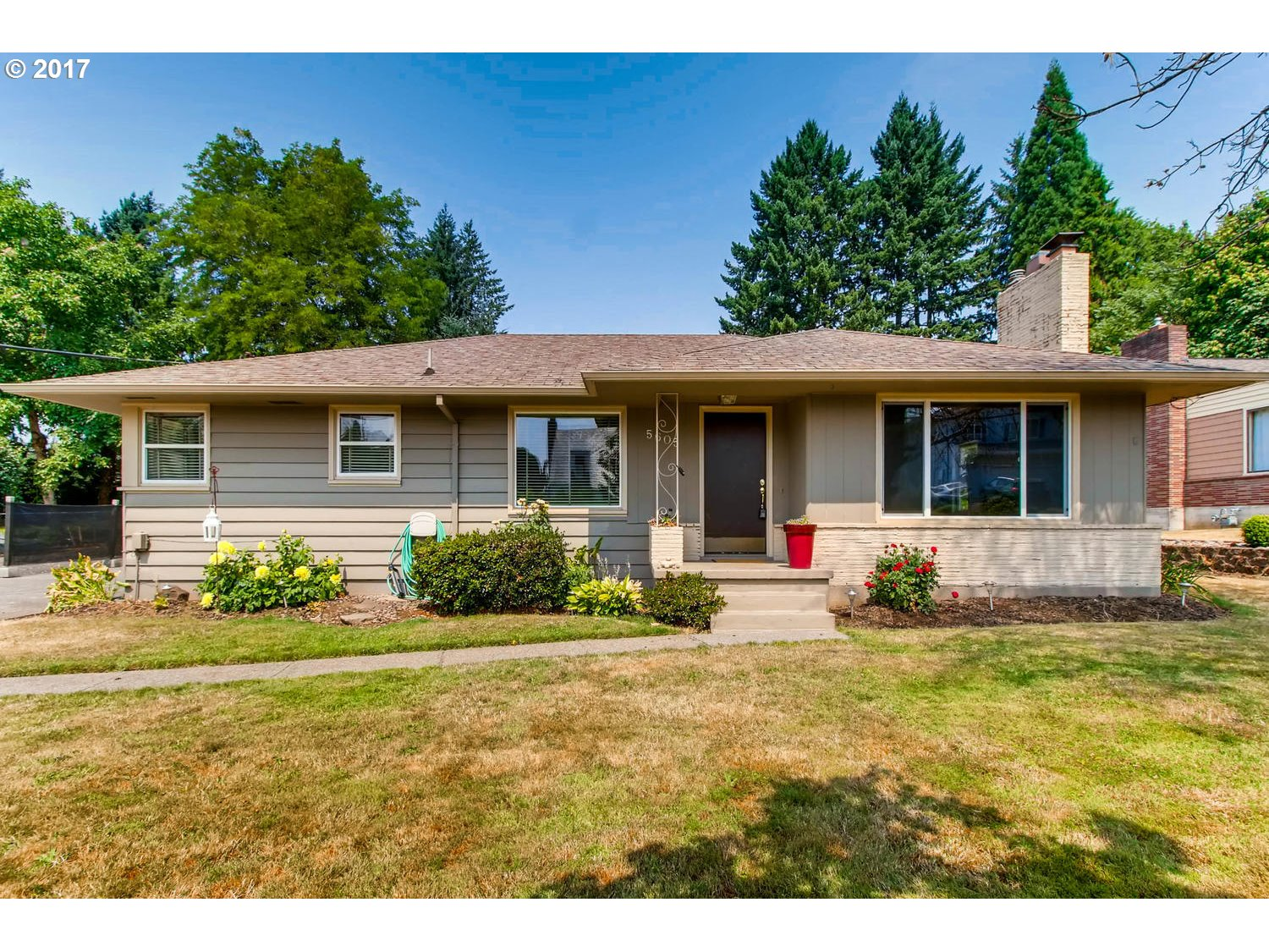 Mid century Milwaukie gem, full of character and charm. Original hardwood floors, beautiful wood burning fireplace with craftsman mantle in living room, and built ins in the dining room make for an inviting space. Newer vinyl windows. Furnace and a/c , possible ADU potential. (buyer to verify) Level lot with gorgeous flowers. Plenty of room to play, garden, entertain. Lots of parking in driveway, oversized garage.