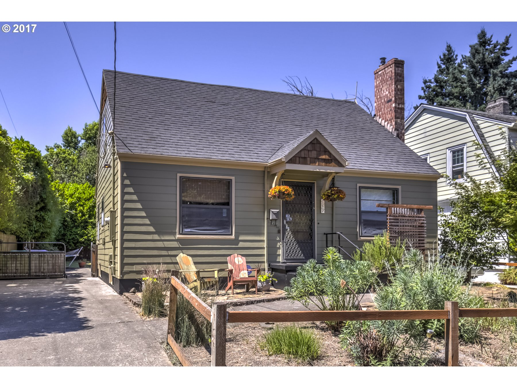 Sweet Kenton Cape Cod across from Mocks Crest. Newly refinished hardwood/fir floors, new exterior paint, hardiplank siding.  Central A/C, updated 200amp panel. Large upper master w/bonus room & landing area.  Finished non-egressed basement rooms. Huge oversized private fenced yard with deck and outdoor storage. A block to Columbia Park, near the bluff.