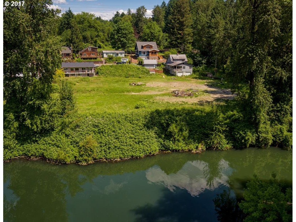 Stunning 2.32 Acres of Waterfront Property in R5 Zone! Home is fixer - sold as-is. Walk out your back door and throw your paddle board or Kayak in the River. Property is next to Spring Park in quiet residential area! Many Possibilities!! Close to bus and Max lines! Very close to downtown Portland!!
