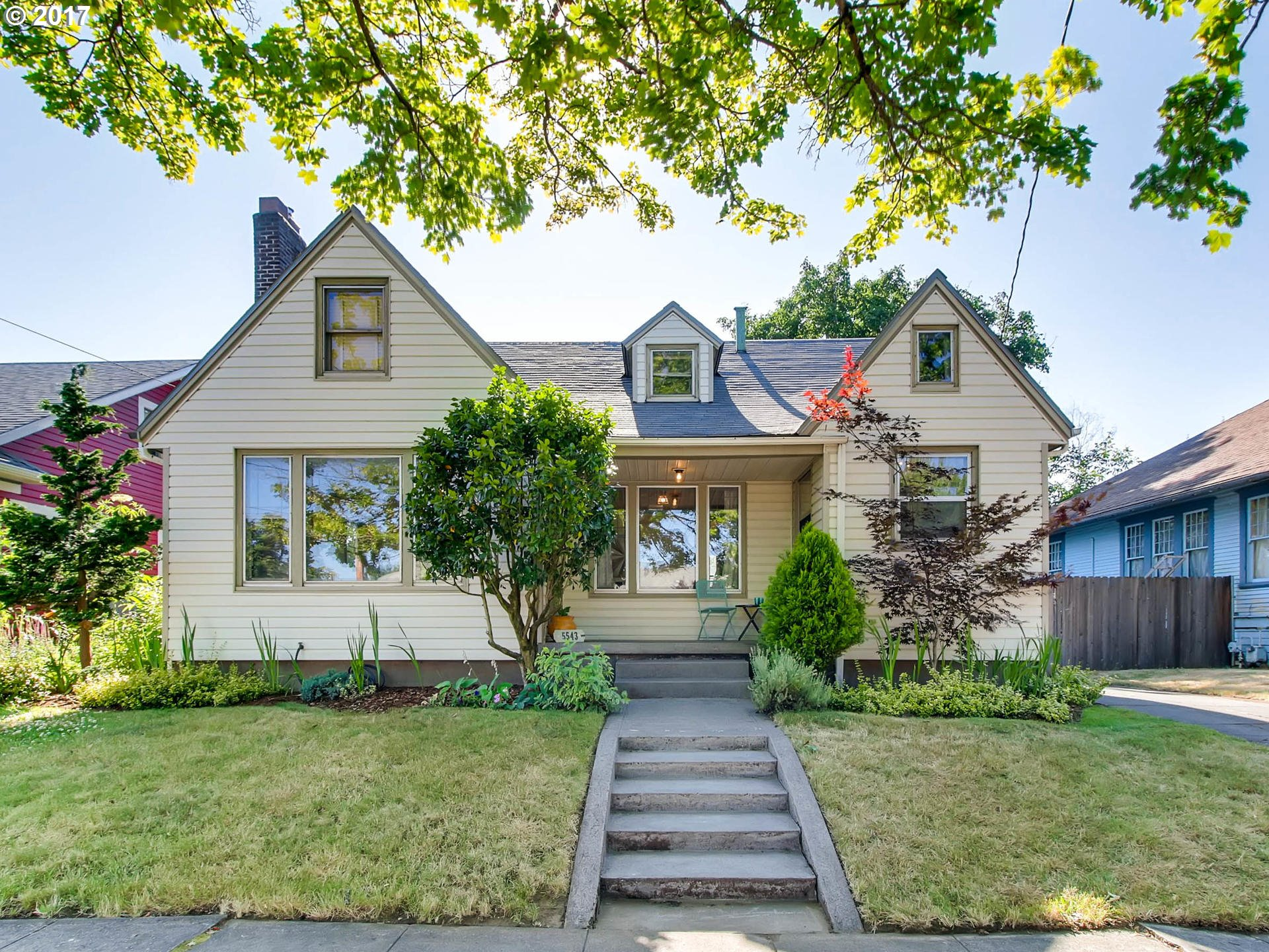 Ideally located, charming Tudor. Orig details incl. frpl in LR, blt-ins, wood flrs, glass knobs. Opportunity to personalize with updates. Lg yard with extended driveway=guaranteed parking in destination nbrhd. ADU potential in spacious finished basement. Restaurants, shopping, groceries, recreation right out your front door! Max Yellow line & Tri-met, easy I-5 access, 10 min to downtown. Biker's Paradise score 99!