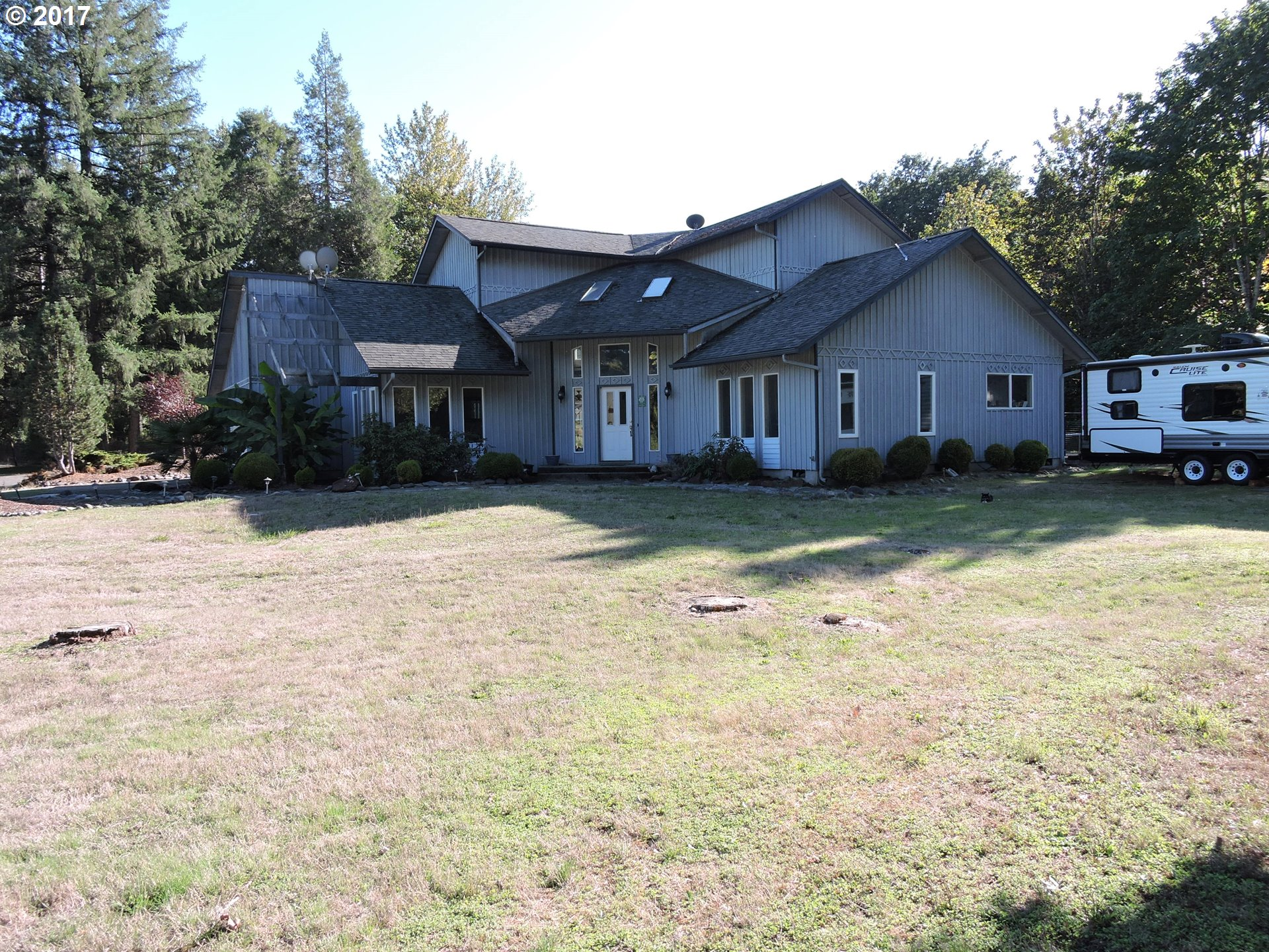 Don't Miss Your Chance To Own This Beautiful Home Near The McKenzie River, Sitting On A Gorgeous 5 Acre Lot. Separate Living Quarters On Main Floor w/Full Kitchen & Vaulted Living Rm. This Lg 2919 SqFt Home Features: Lg Master Suite w/2 Walk In Closets, Jacuzzi Tub, Shower, Deck & Walk In Attic/Storage Space. 2nd Bedroom W/Walk In Closet. 2 Rv Spots w/ Electricity & Water. One 2 Car Garage & Separate 1 Car Garage. Fenced & Cross Fenced.