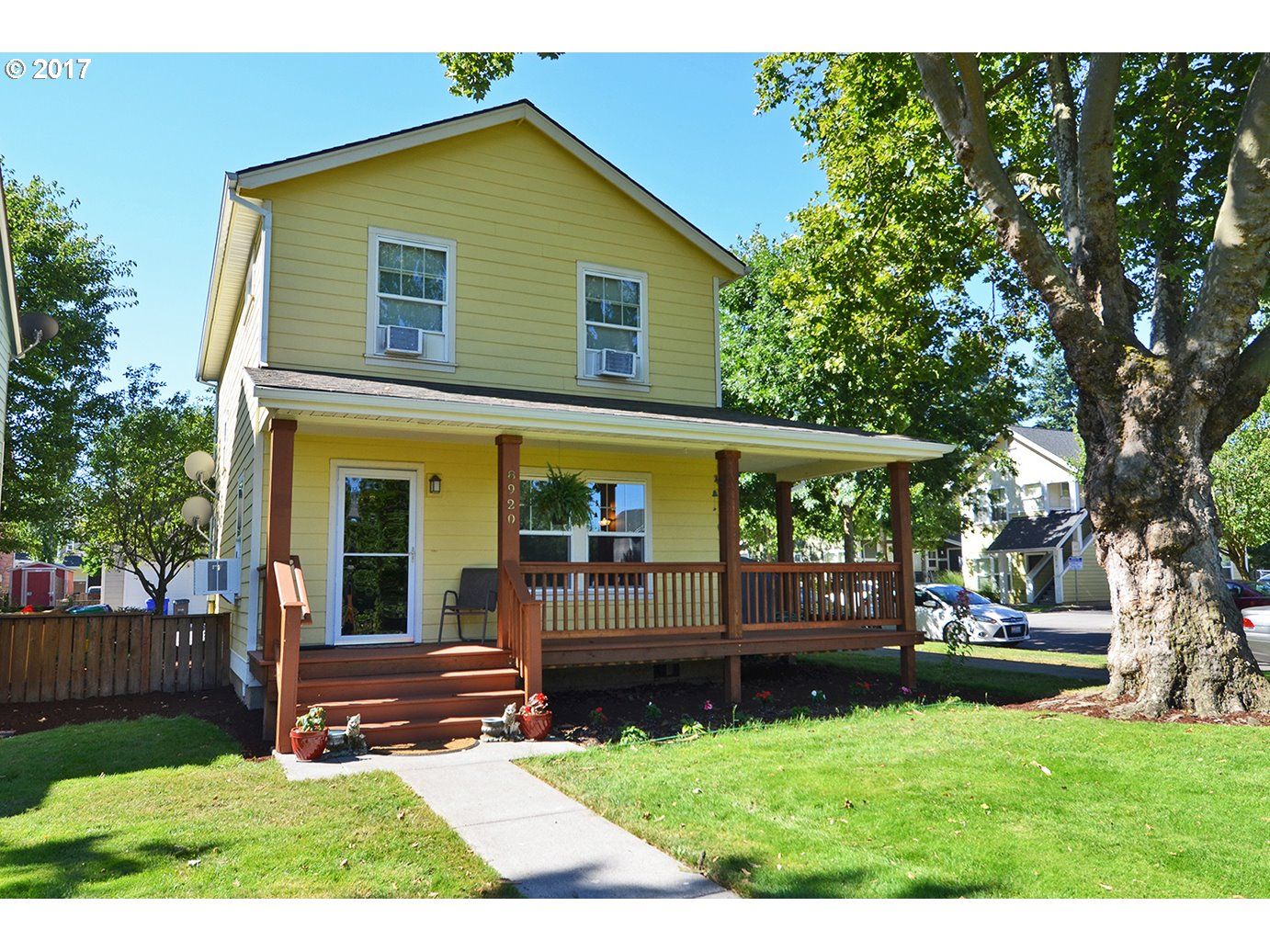 Price Reduced! Enjoy relaxing on the front wrap around porch while enjoying the views of the courtyard! Bamboo floors on the main level. Gas fireplace. Large kitchen.  Full bath on the main level.  4 window air conditioning units. Tankless hot water heater.  Parking for 2 vehicles. Walk to parks and school. Close to the boys and girls club.