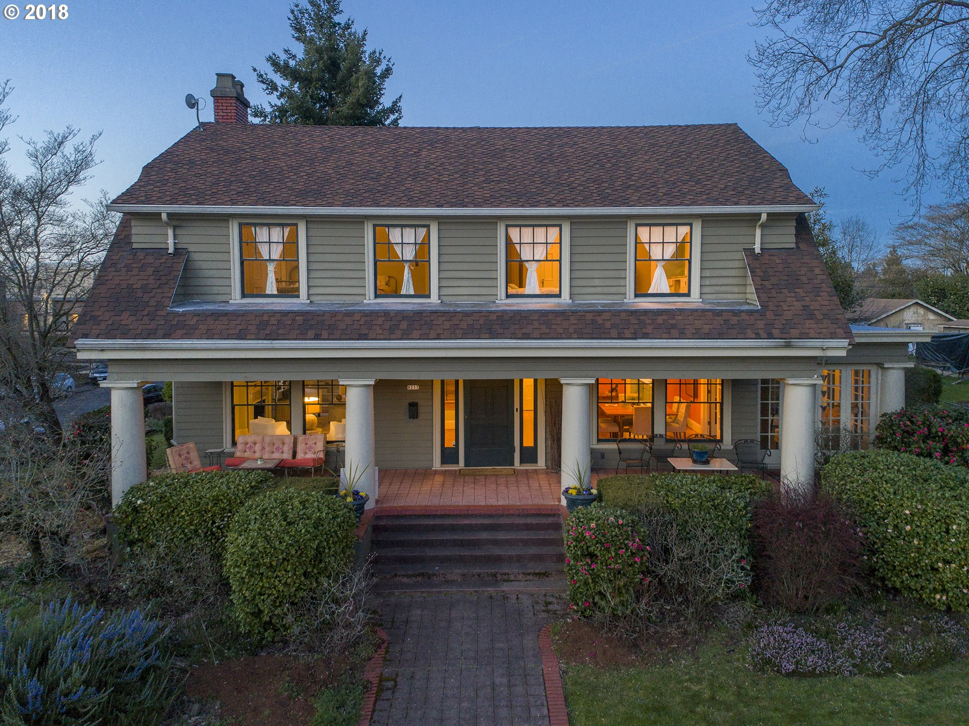 This grand 15 room home built by Thomas Auzten, of Autzen Stadium @ U of O, now on the market by its current steward.This tastefully restored Dutch Colonial has views of St. Johns Bridge, Willamette River & forest park, 60 Ft.covered porch w/ massive columns.Grand staircase, egg-&-dart molding, built-ins 3 bright & spacious bedrooms upper flr, 3 sun rms,Guest Quarters, w/separate ent. 2 fireplaces, updated kitchen.