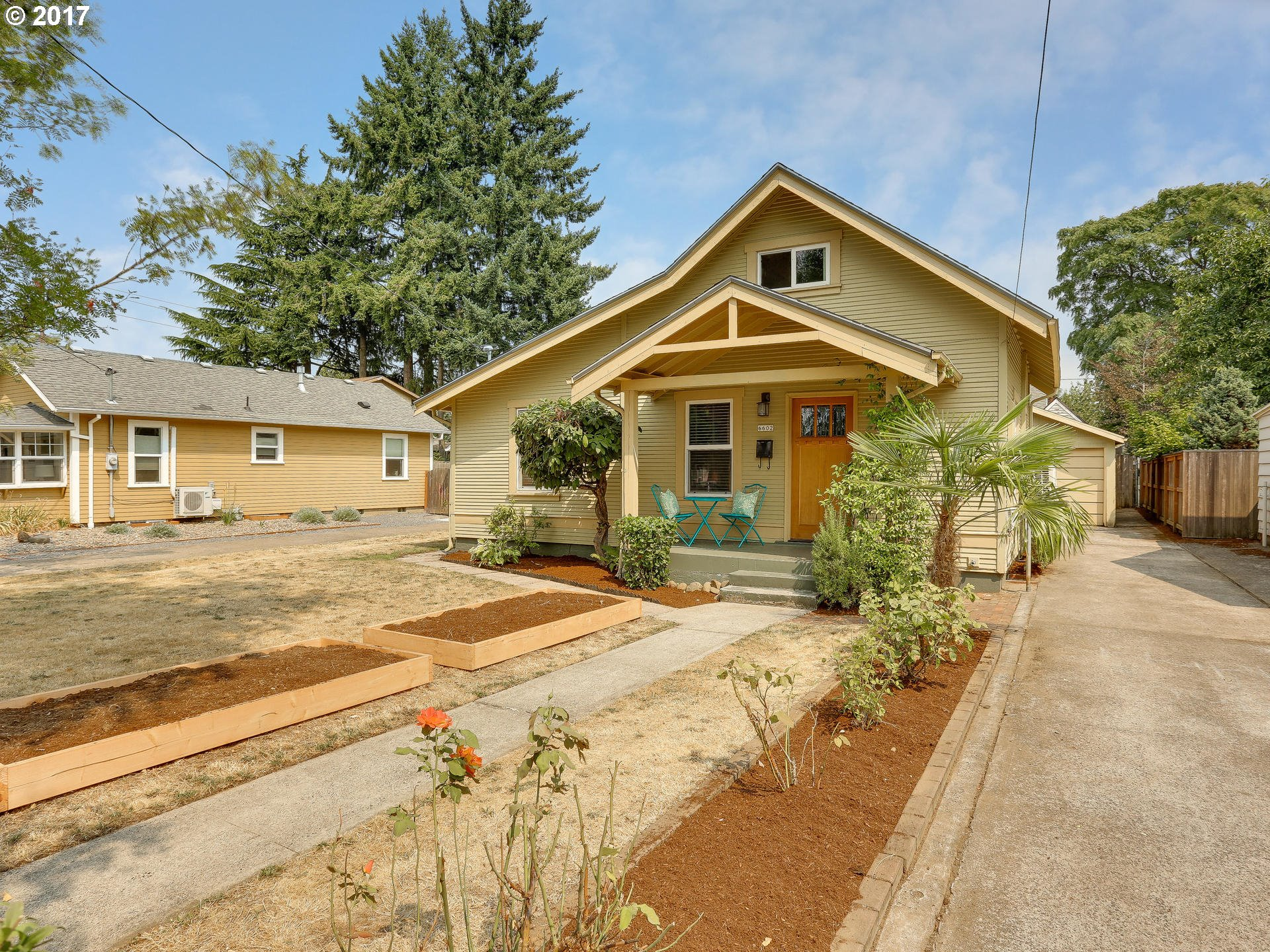 The Arbor Lodge sweet spot! Sunlit vintage charm, smart, efficient updates, big open kitchen, sunny yard w/raised beds + privacy, detached garage + lots of opportunity!