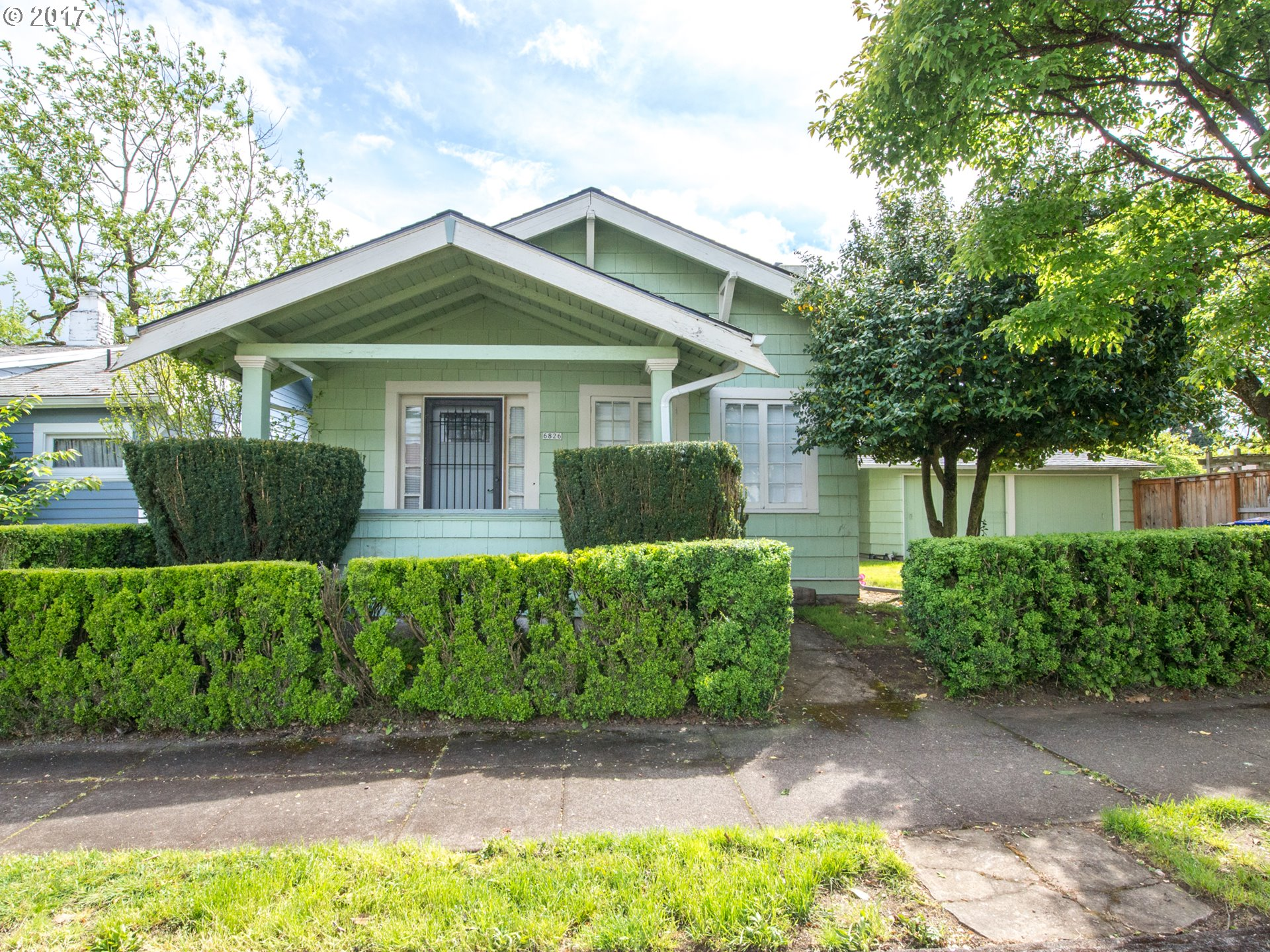 Piedmont Bungalow!  1919 built home cute as a pink button!!  Original detailing, wood burning fireplace, wood floors, old school kitchen, unfinishedbasement. Attached 2 car garage with breezeway on 2600 square foot lot. Charm, Charm, Charm! Sweet front porch + great street in NOPO.