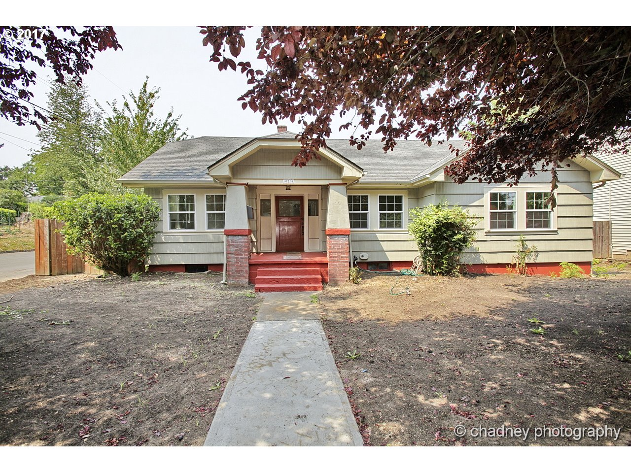 Wonderful refurbished Bungalow with lots of charm and room for all,4 bedrooms + den area,2 full baths (Master bath)Beautiful hardwoods throughout,New Vinyl windows,fresh paint,Trim work, built-ins,newer updated/remodeled kitchen,great open area for den/bonus room with open staircase, kitchen with nook,Custom interior bdr & back doors on order. Lg. corner lot and room for lg. shop/garage, freshly done 17 yds of 3 way soil sod/seed ready.