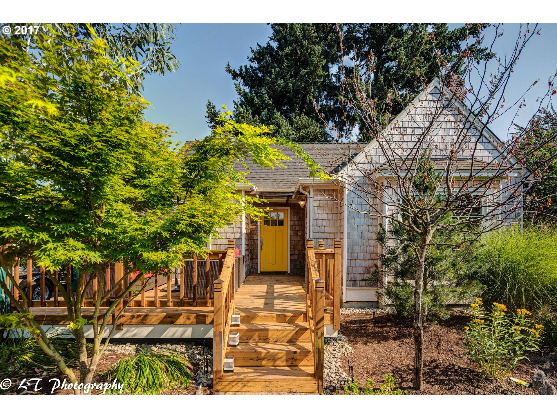 It's like being on vacation everyday. An oasis in the city. Terrific inside & outside living. Master on the main, 2nd bedroom upstairs and 3rd + 4th bedroom in basement non-conforming. Deck in the front and large deck in the back for outdoor living. Fenced side yard with grapes. Fenced backyard, low maintenance landscaping front and back. Large shop that could be future ADU. Kenton, Columbia, Arbor Lodge Parks, Portland Village School.