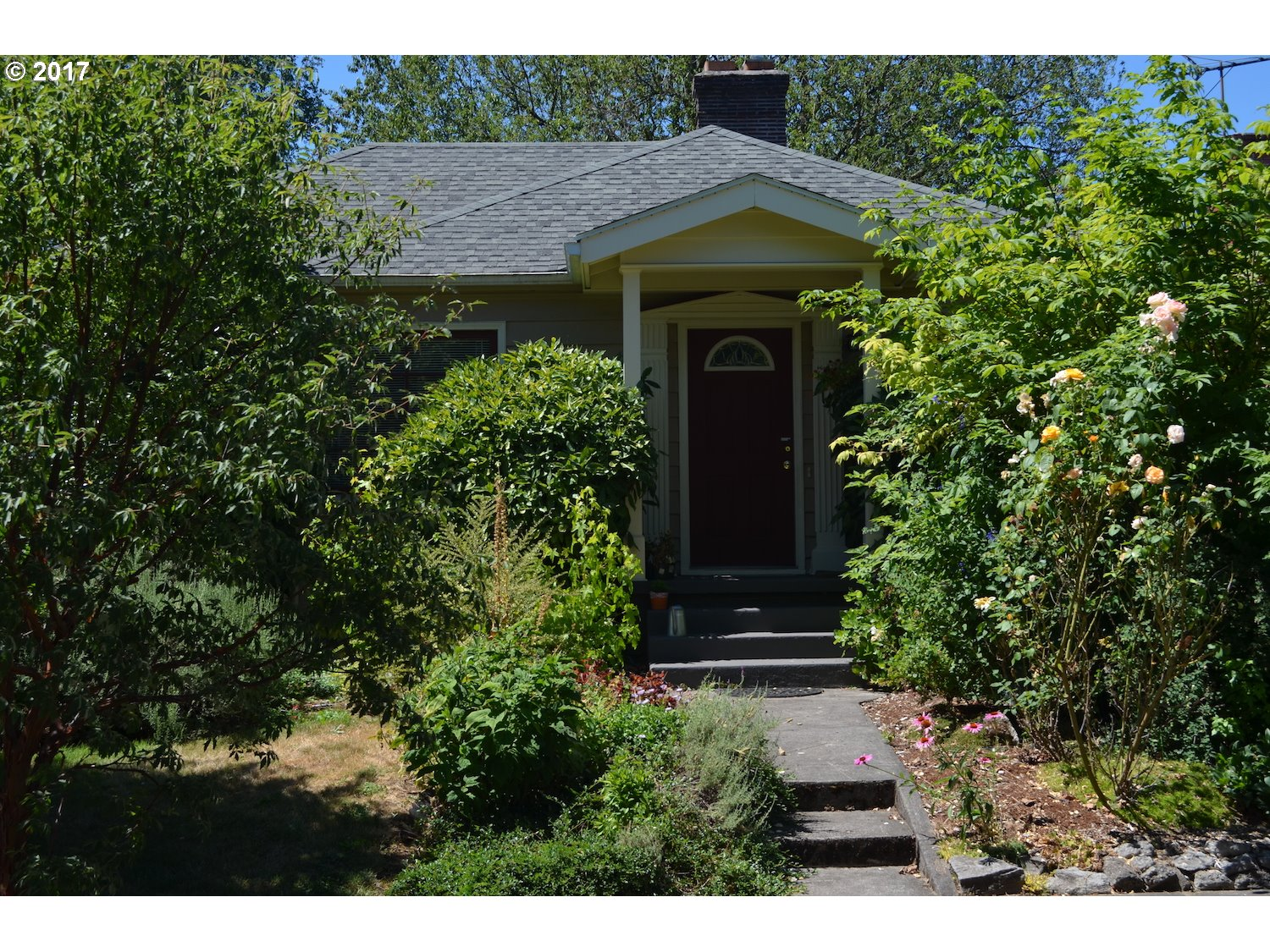 2 bdrm/1 bonus. Charming 1941 home w/wood floors, dining room, built-ins, fireplace, corner windows, retro kitchen w/ original chrome hardware, refurbished range. Basement w/ finished bonus room, family room, and extra storage. Lovely, fenced yard with deck and playhouse. Greenhouse, planting boxes, and watering system. Detached garage. Newer roof, gas furnace, windows, new repipe, oil tank done.