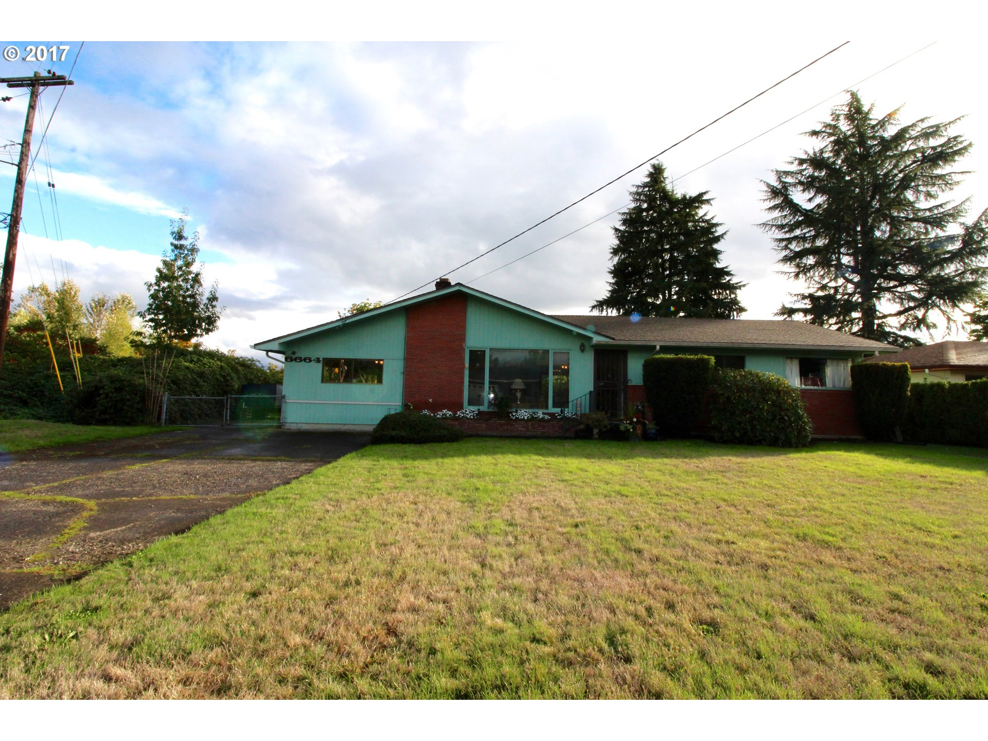 Untouched 50's ranch!  Hardwood floors throughout, covered with carpet for the past 50 years!  Over a 1/4 acre lot with room for RV parking.  Don't miss your opportunity to create your own Mid Century Masterpiece!