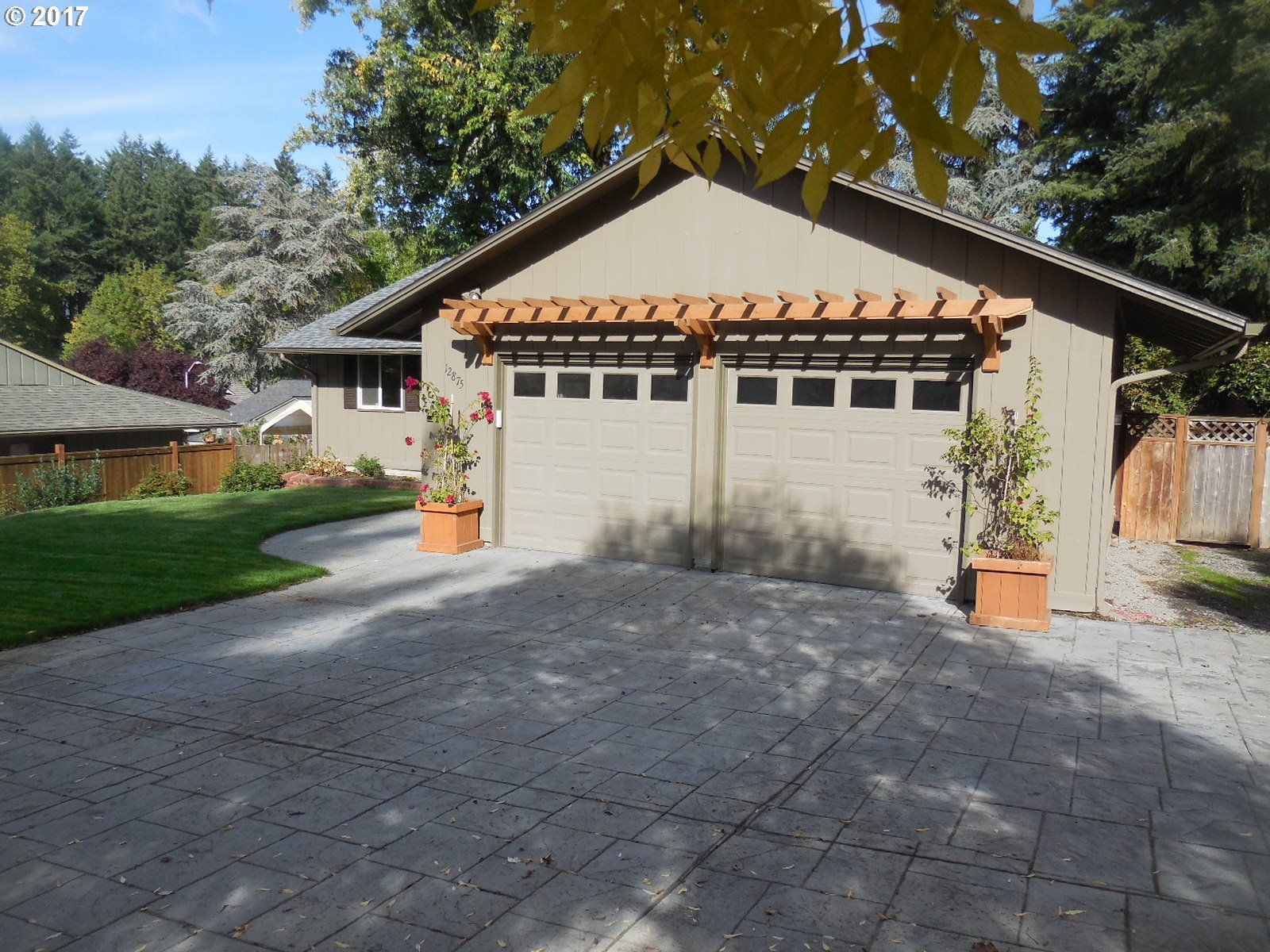 OPEN HOUSE 9/24,  12-3PM. Not a surface untouched in this stunning 2,708 SF 5 bedroom  3 bath home. The remarkable  renovation includes high end finishes throughout. All new baths, kitchen with island/eating bar,  granite counters, hardwood, tile, carpet,  new heat pump w/ A/C for main level, fresh interior & exterior paint, a newer roof,   Private fenced yard. New front sod & new front sprinklers. Desirable neighborhood, & more.