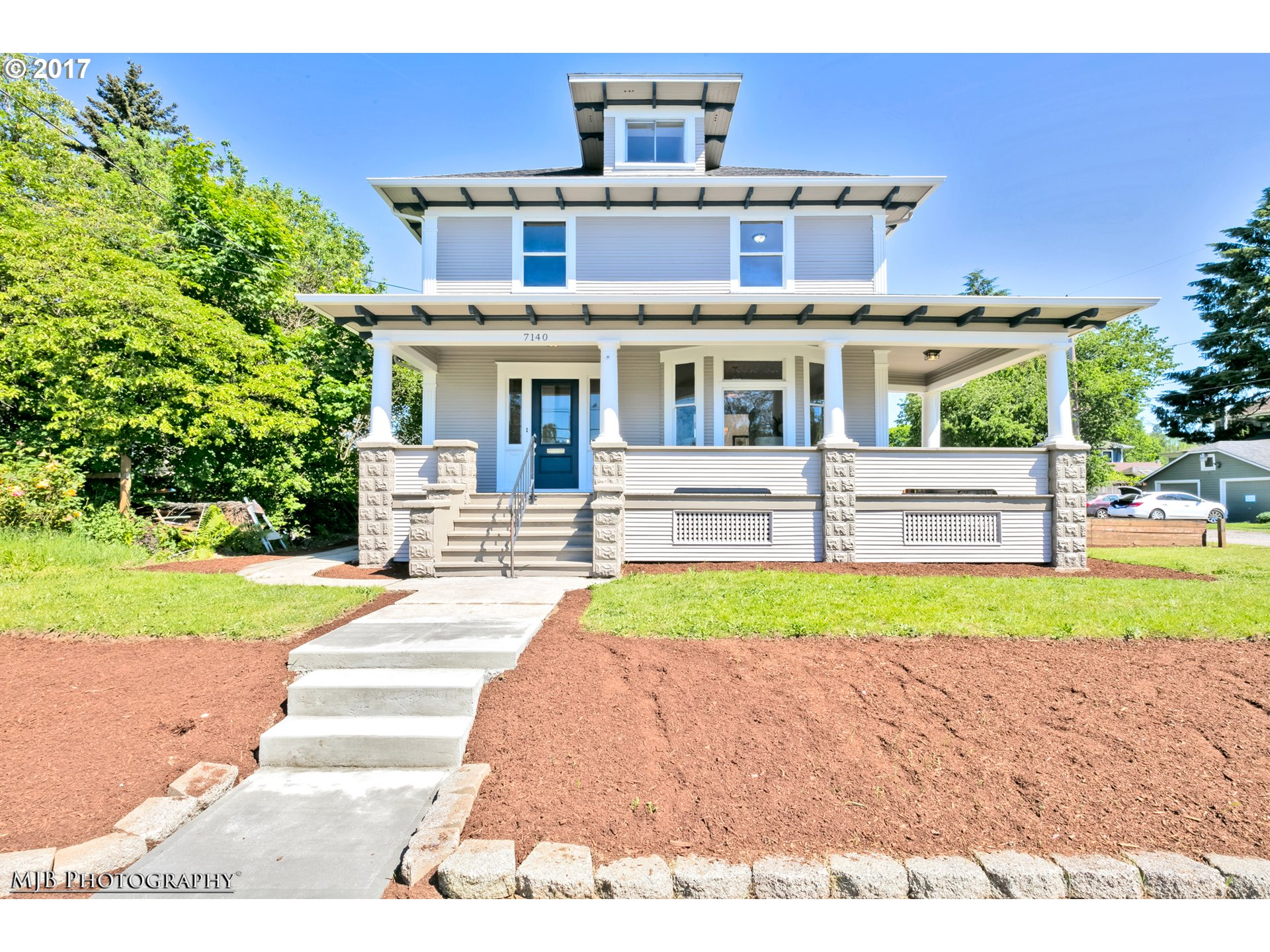 Classic Old-PDX style home in pop University Park neighborhd!  Move-in ready! All new designer int/ext paint, charming & huge covered wrap around porch, 4 levels of spacious living, finished basement, vaulted attic space, entertainers kitchen w/SS apps, built-ins, hi-ceilings thru-out, plenty of natural lites, remod bthrm, AC.  Near shops, parks, cafes, & walk-able tree-lined streets! Hurry, won't last at this price and location!