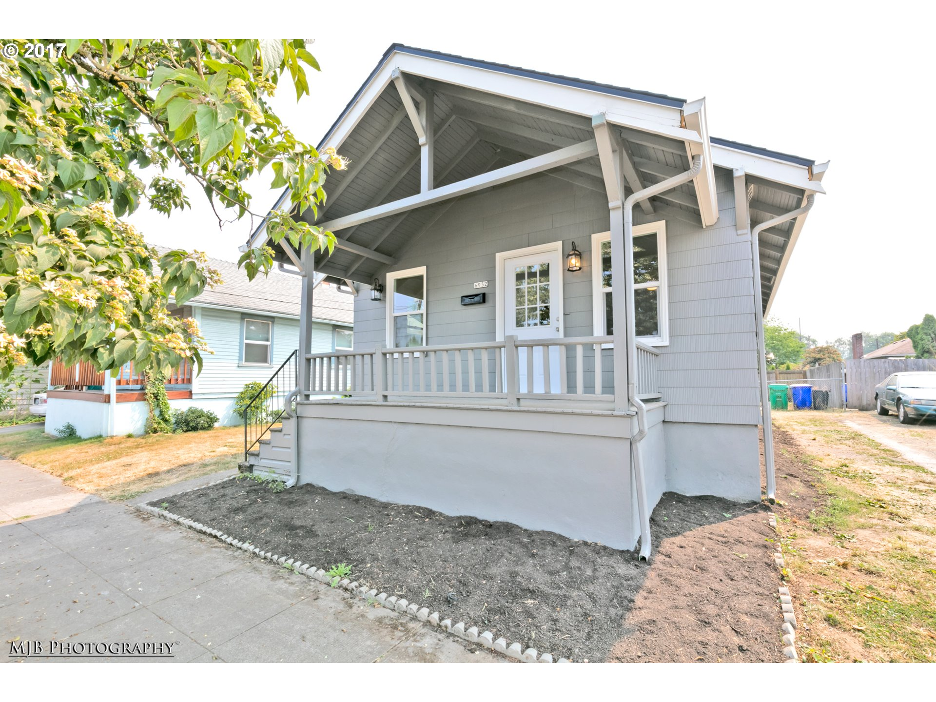 Charming PDX style home in popular St. Johns neighborhd! 83 WalkScore & 96 BikeScore! Features inc: covered front porch, all new paint, beautiful wood flrs, full unfin basement,  beautiful open kitchen w/new SS apps, all new lighting & plumbing fixtures, brushed nickel hardware, remod bathrm, forced air natural gas heat, new millwork, vinyl windows & more all on a private, partially fenced yard!