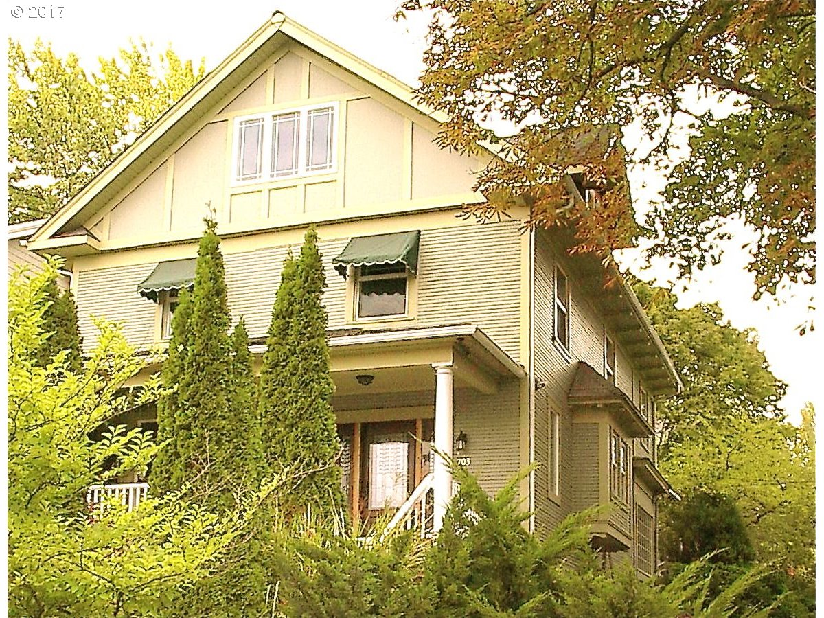 Mississippi District Beauty! Three floors (plus basement) all totally new and completely rebuilt inside, sitting high above the street with great views. First floor: comfortable front porch, a spacious foyer, natural wood trim living and formal dining room, guest room/office, bath, large eat-in kitchen, private backyard. Second floor: three bdrms, bath, laundry, yoga/art room. Third floor: master suite/bath. Close to everything.
