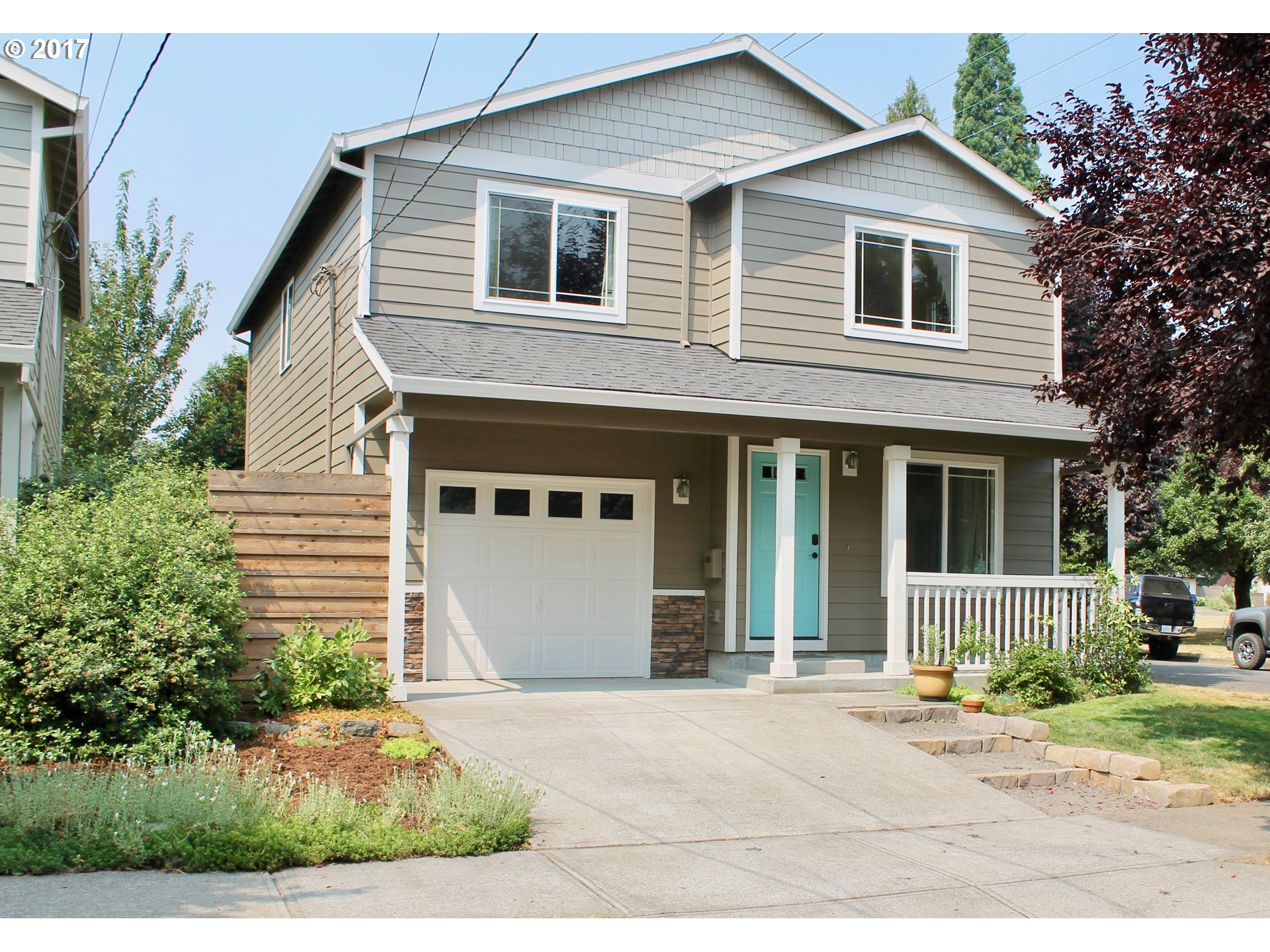 Beautiful N. PDX home in desirable Kenton Neighborhood! Fresh exterior paint and newer laminate floors make this 4 bedroom 2.5 bath home on a corner lot across from Trenton Park a must see! Floor plan provides large bedrooms and living areas. A peaceful backyard oasis includes patio, grape vines, garden area, and fruit trees. With a bike score of 84 and room for the whole family, this home is as comfortable as it is convenient!