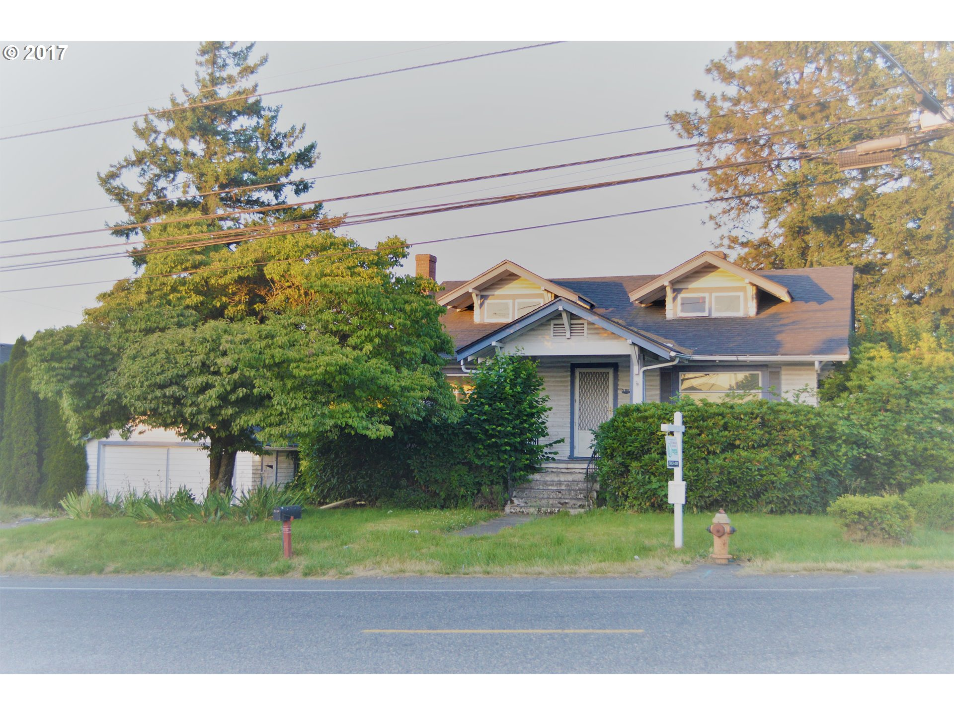 Good old Bungalo house w/ huge over 17,000 sqft corner lot with two street access gates. Four bedrooms & 2 baths, brick fireplace, woodwalls, formal dining room, finished basement w/ in & outside access, huge porch & more. Seller's investment property so please do your own research about the property. Please check w/ your lender about the presidential on the commercial zoned. Perfect for living & working as one. Seller to do no repairs