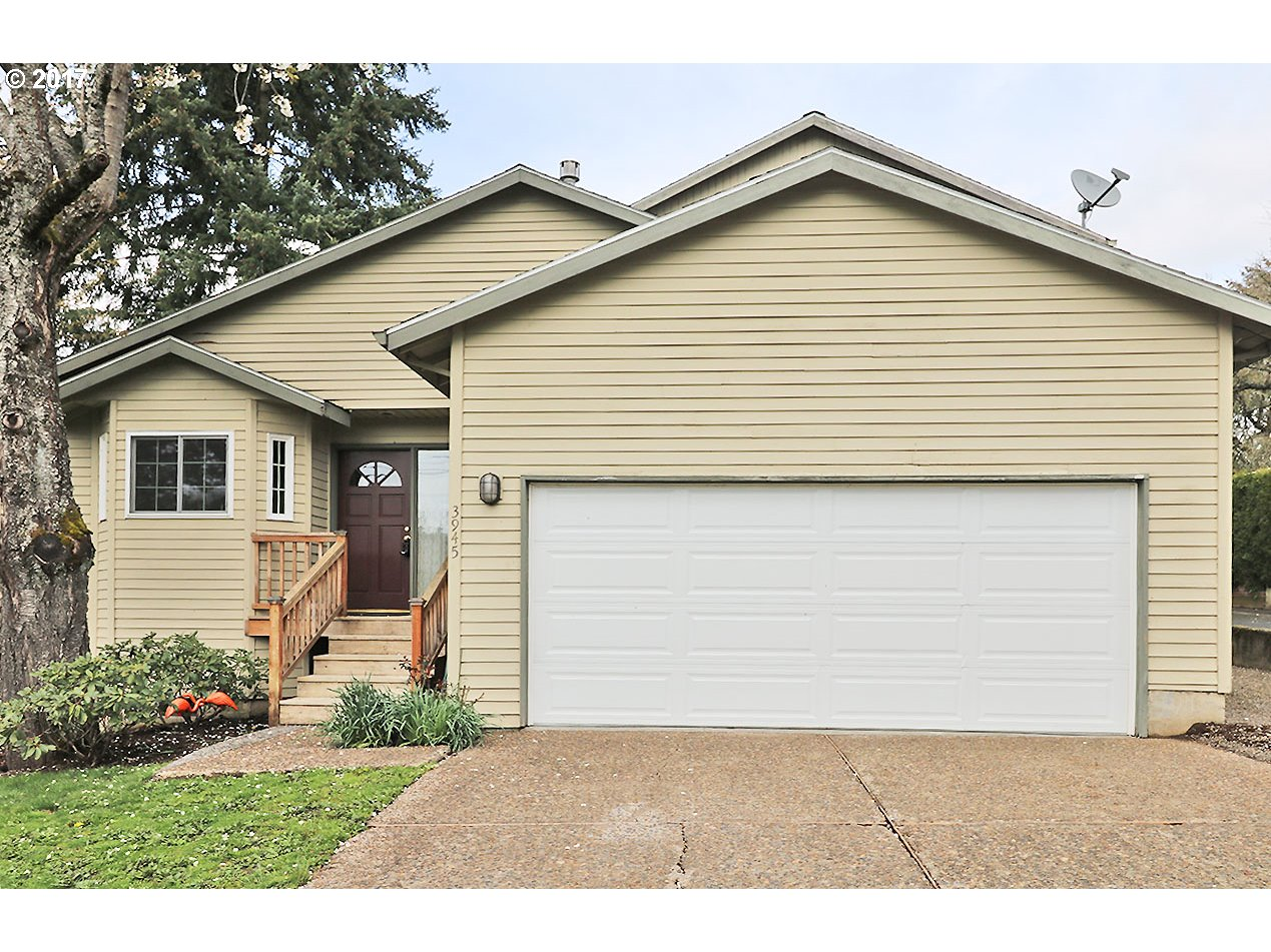 Awesome location! Just 2 blocks to all the restaurants, shops & cafes in Multnomah Village-Gabriel Park just 2 blocks at dead end . Beautiful remodeled gourmet kitchen great room has bamboo floors, huge island, lots of high quality cabinets, dining area & living room w/fireplace & french doors to deck & yard. 2 masters, both have full bathrooms & walk in closet, one upstairs and one on main. 3 full bathrooms!  Private grassy front yard.