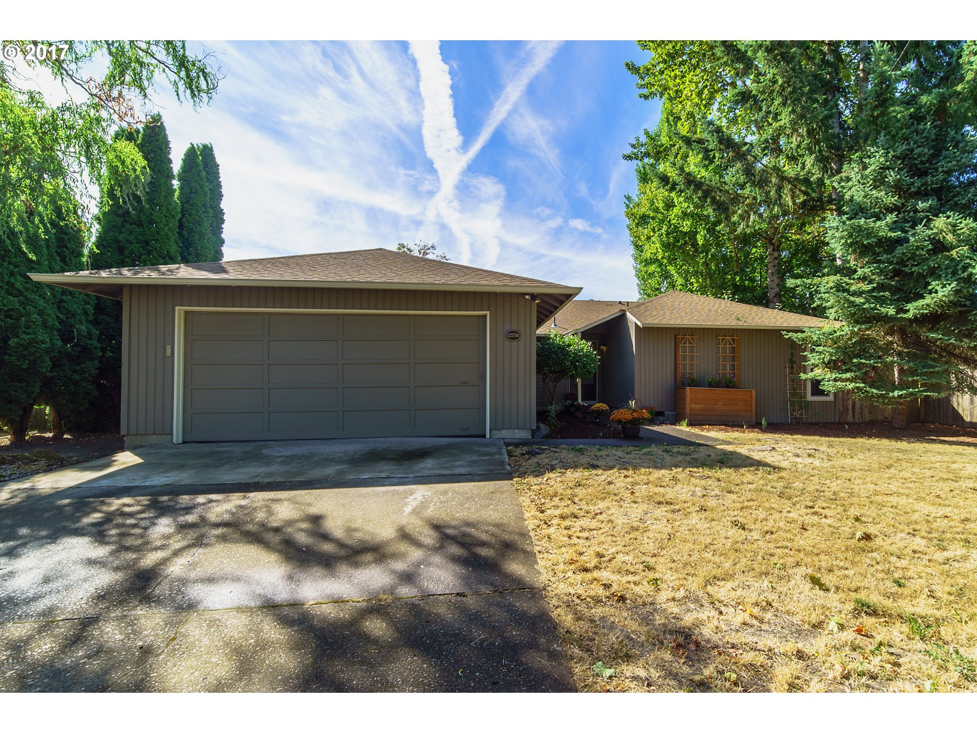 Turn key home with all the updates, appliances included! Private and manageable yard, new deck and doors just added overlooking the space. Newer flooring and lighting throughout with many windows replaced and upgraded. Super convenient location from schools and only 1 block from the Rec Center!