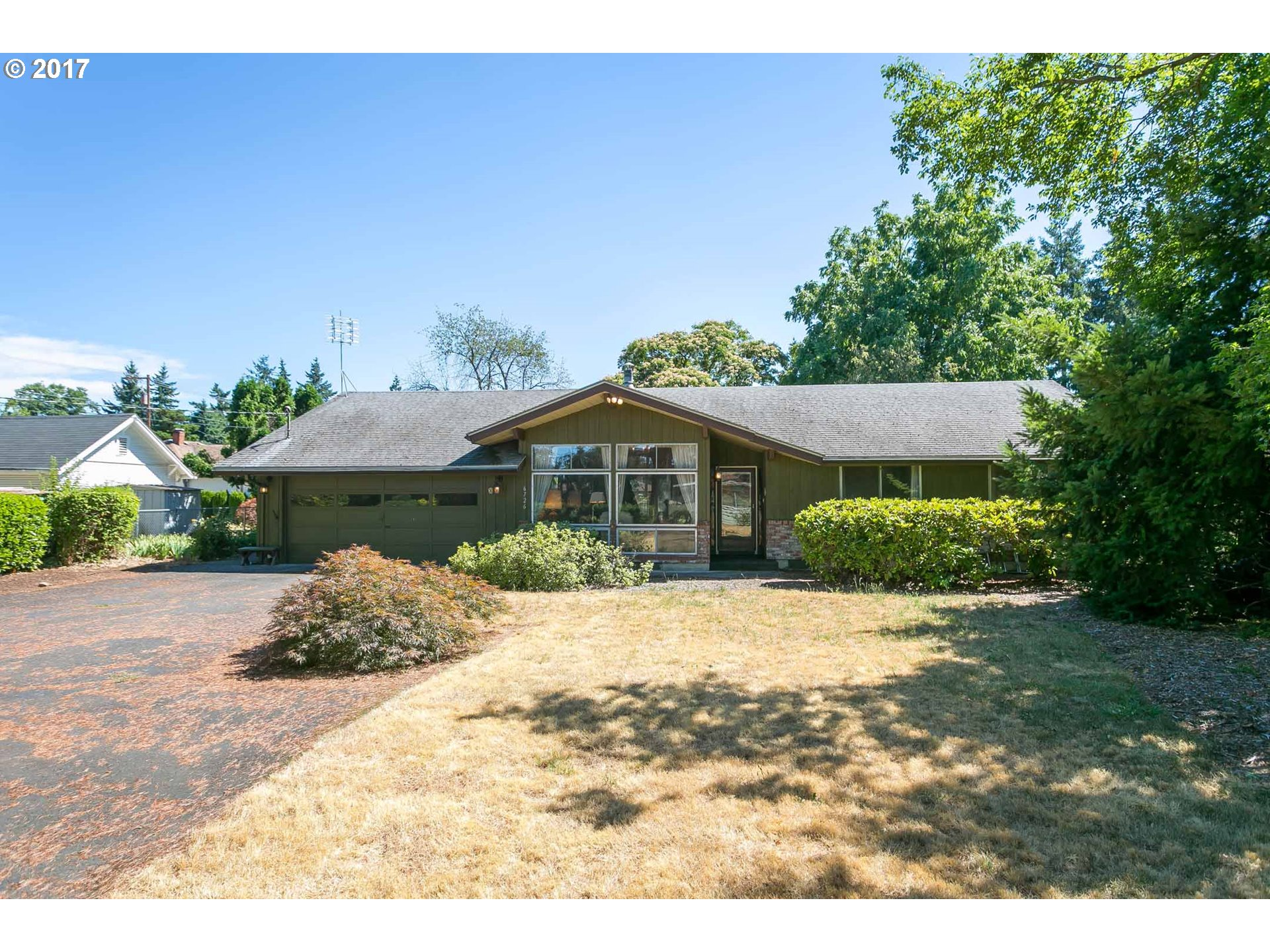 CALLING DEVELOPERS,REHAB-ERS AND BUYERS WANTING 2 HOUSES ON ONE TAX LOT. 1/2 ACRE w/R-7 ZONING.BUILDER PACKET AVAIL. Only 2 owners/ every surface original. Hardwood floors in most areas. Vaulted cedar ceiling and open floorplan just needs gentle facelift.Kitchen overlooks BIG backyard and covered patio. Smaller house is 1 bdrm, 1 bath, w/dining & living areas,kit, big utility rm.  guess about 800-850 SF.  Has been rented for years