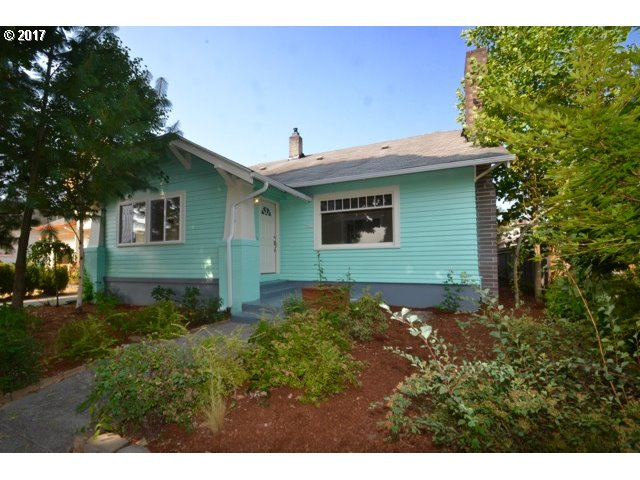 Centrally located in a great neighborhood and nicely updated. Lovely light & bright large living and dining rooms as well as 2 bedrooms on the main floor.  Updated large kitchen with new appl & wine cooler. Fresh paint inside and out, wood-burning fireplace vinyl windows, newer roof and beautiful hardwoods + fir floors.  Great flow & upper bedrooms are nice sized too. Exterior entry to basement for potential future dev. Welcome Home!
