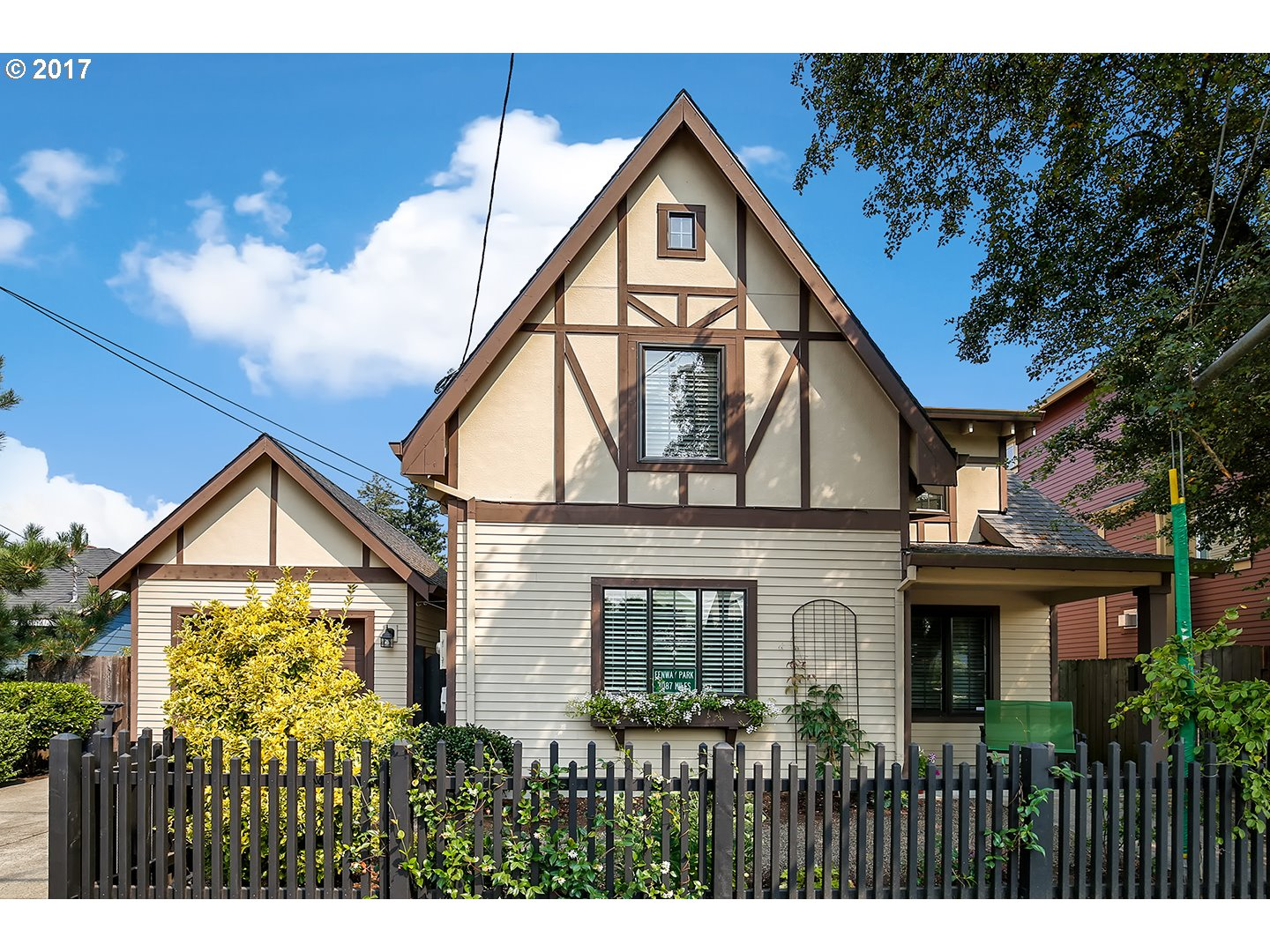 One of a kind Tudor style home, immaculate condition! Welcoming porch, sit relax, before walking inside to a charming open concept main floor. Lovely staircase to the 2nd level w/ a large master suite, closets & storage plenty, down the hall: 2nd bedroom, office space, laundry room. Backyard is private with a SynLawn(heat resistant+animal friendly), recycled tires as bark dust. Covered patio! GreenHome! NewSeasons+Starbucks close.