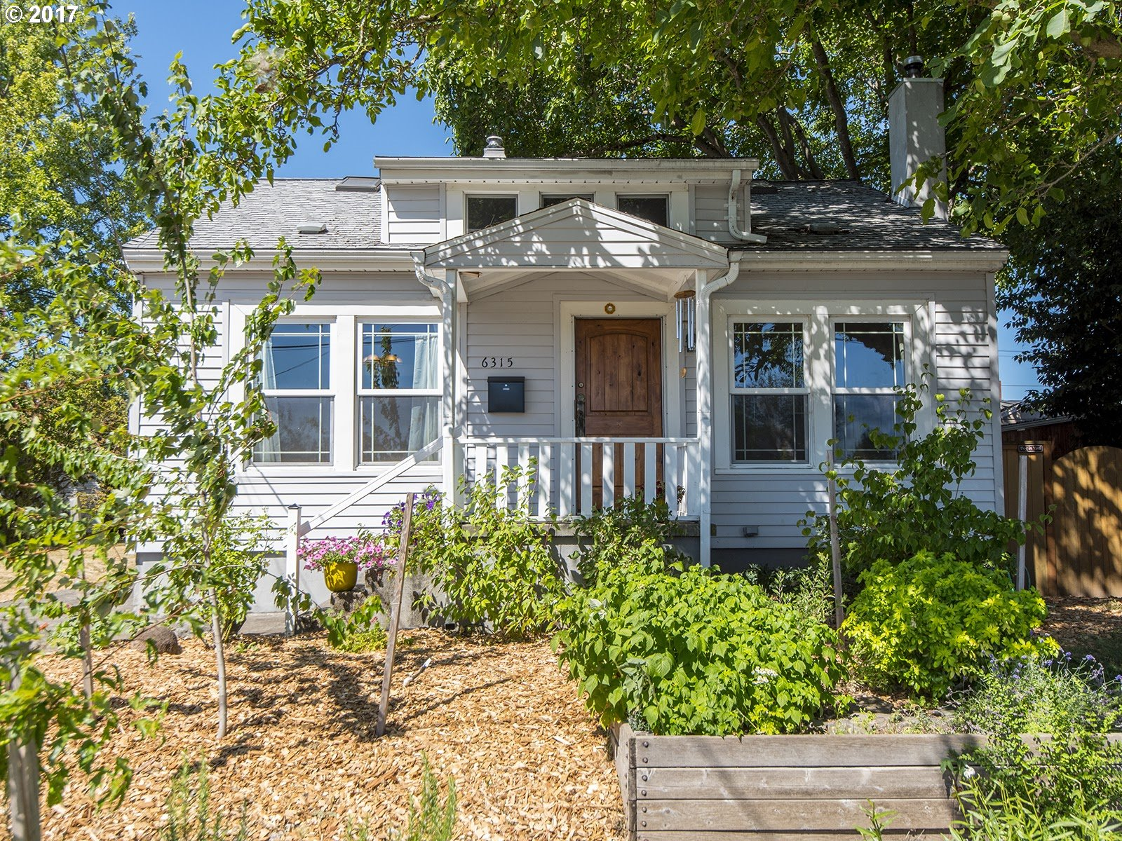 Sunny bungalow full of charm in coveted Arbor Lodge! Wide open living/dining/kitchen. Fireplace, built-ins, wainscoting. Master suite & W/D on main. Updated bath. Two beds up plus secret playroom. Mud/laundry room on main, ample basement storage, rare 2-car garage. Many updates throughout! Fenced, private backyard w/ patio, organic gardens, drip irrigation. Walk to MAX, New Seasons, coffee & more. Easy access to commuting routes!
