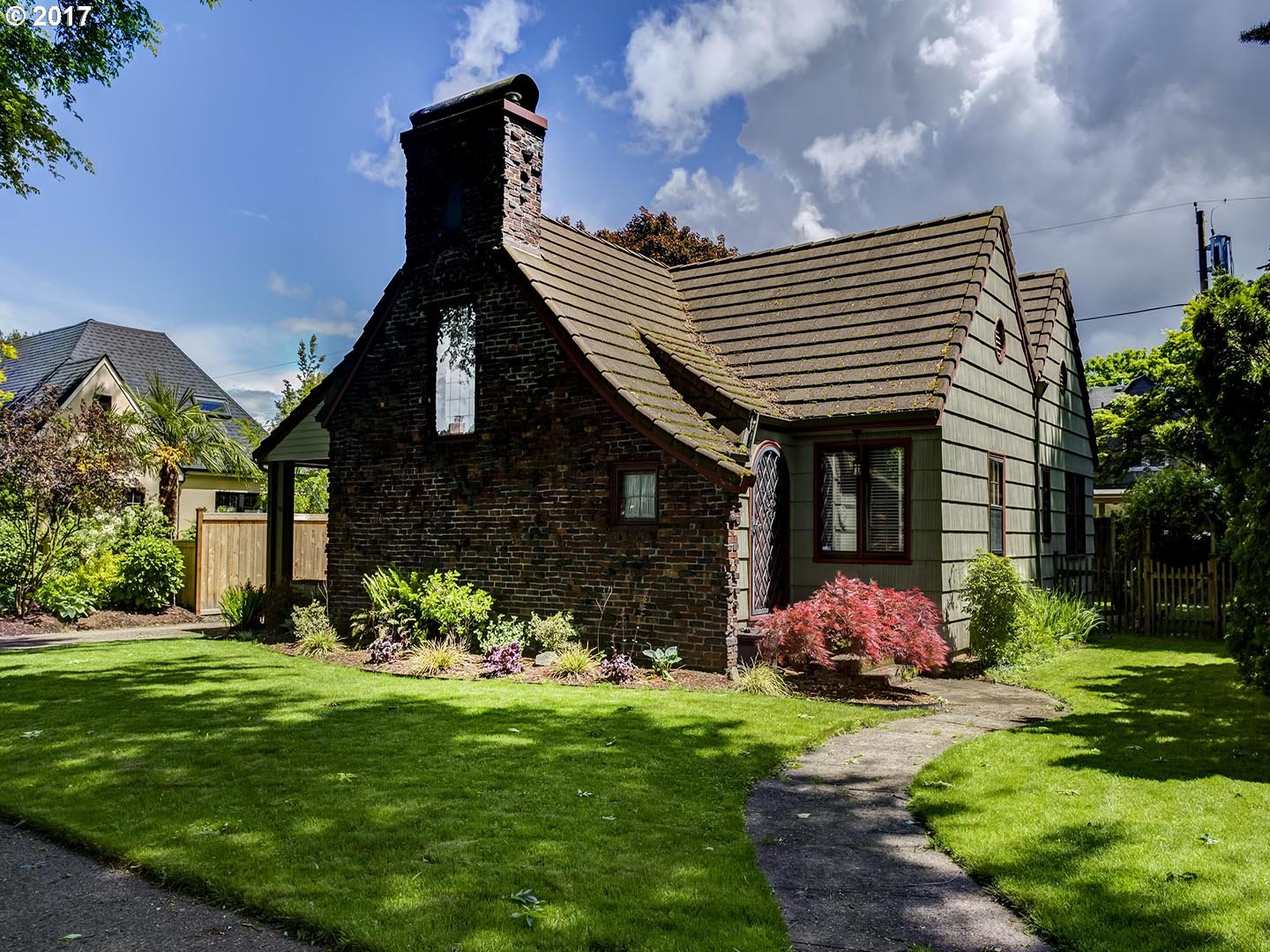 Wonderful English cottage in desirable Mock Crest. Impressive living room with vaulted wood beam ceilings and a beautiful river rock wood burning fireplace. Large dining room that leads to an updated kitchen with an eat in nook with lots of natural light. Finished basement makes a great TV room with a large laundry room and bathroom. Over sized lot with large detached garage.