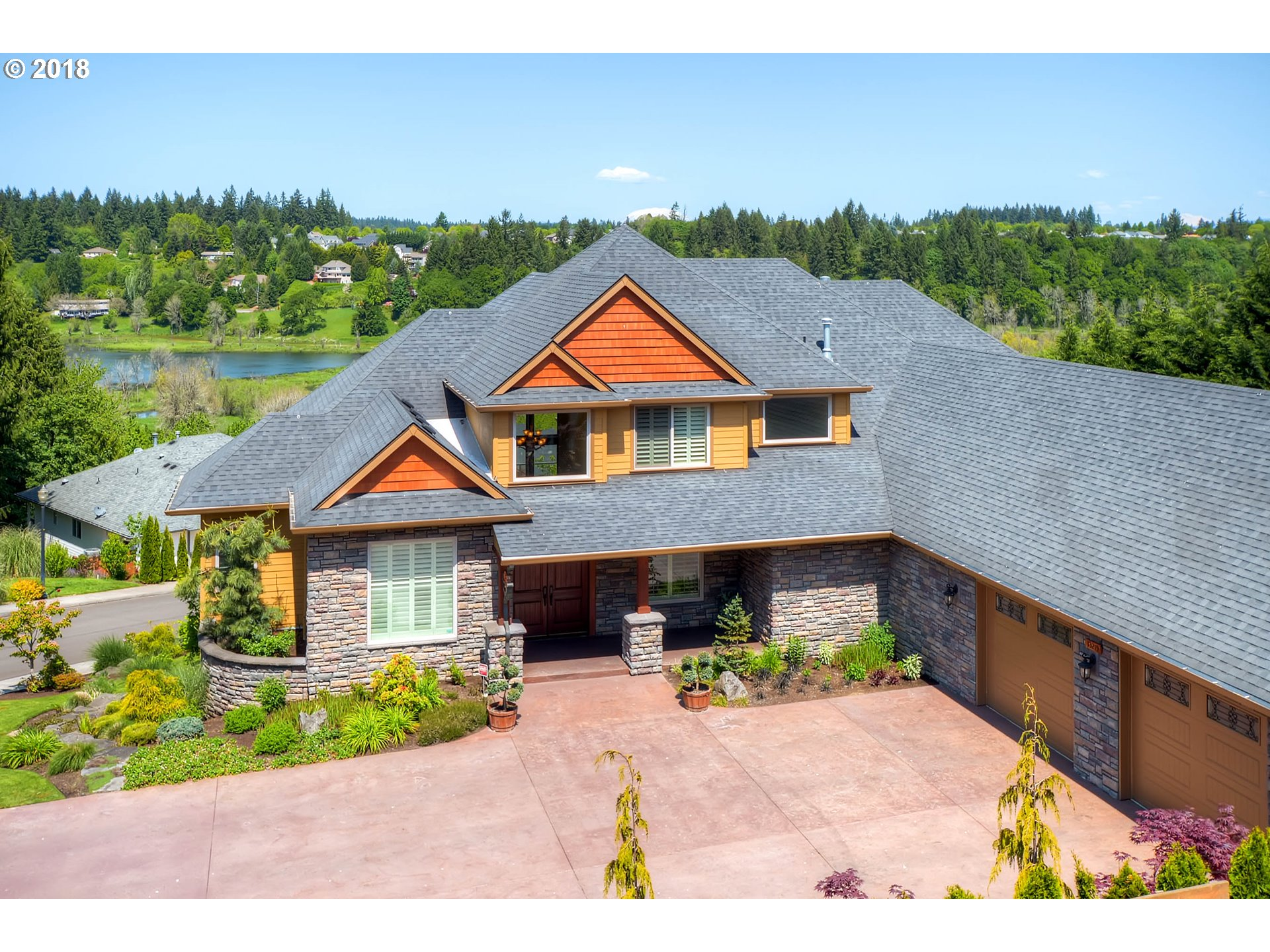 Better than NEW! Stunning 6,000+ sq ft home overlooking Salmon Creek. Perfect for generational living. Approx 3,700 feet on upper 2 floors AND almost 1800 feet downstairs including full kitchen. Granite, Travertine, hardwood, freshly painted exterior, 2 huge decks overlooking creek, 650 sq ft of storage. Park all your toys in the over 1850 sq ft garage! 6+ cars will easily fit. 2 heating systems, recirculating water plus more!