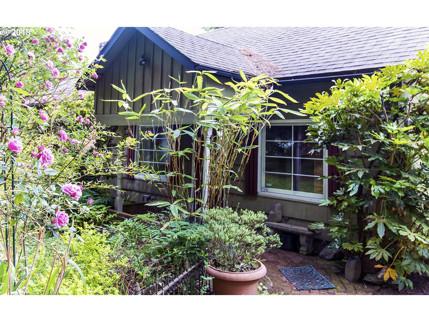 Awesome location-Walk to shops-restaurants-Rec Center-Fanno Creek Trail just 2 houses away!Could be bedroom in family & loft -Lot is dividable! Half the house built in 1970s, half in 1920s. New section has soaring vaults-fireplace-leaded glass windows-Huge Family room w/french doors to deck. Lot is gorgeous-It is .44 Acres-Very private w/pretty trees.Could be divided into 2 .2 acre lots! Sewer to go in this summer w/extra sewer stub
