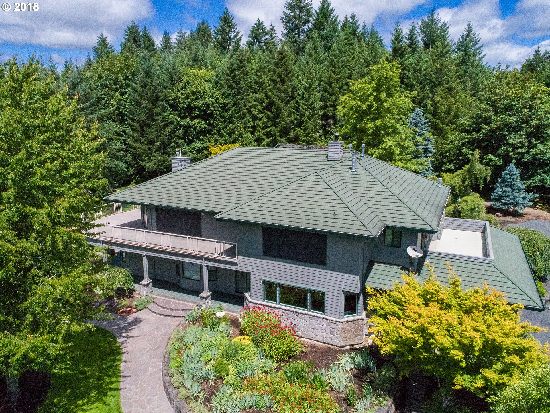 Built in 1997 and recently remodeled, this sprawling and private, 34+ acre property has it all. Master on the main with luxurious bath and flowing, open floor plan. 6,000+ square feet of gracious living space. Enjoy 2 home offices, 1 with sitting area and enormous wraparound terrace. Seamlessly entertain from luxury kitchen to built-in outdoor grill on expansive stone patio. The wandering grounds include hot tub area and greenhouse.