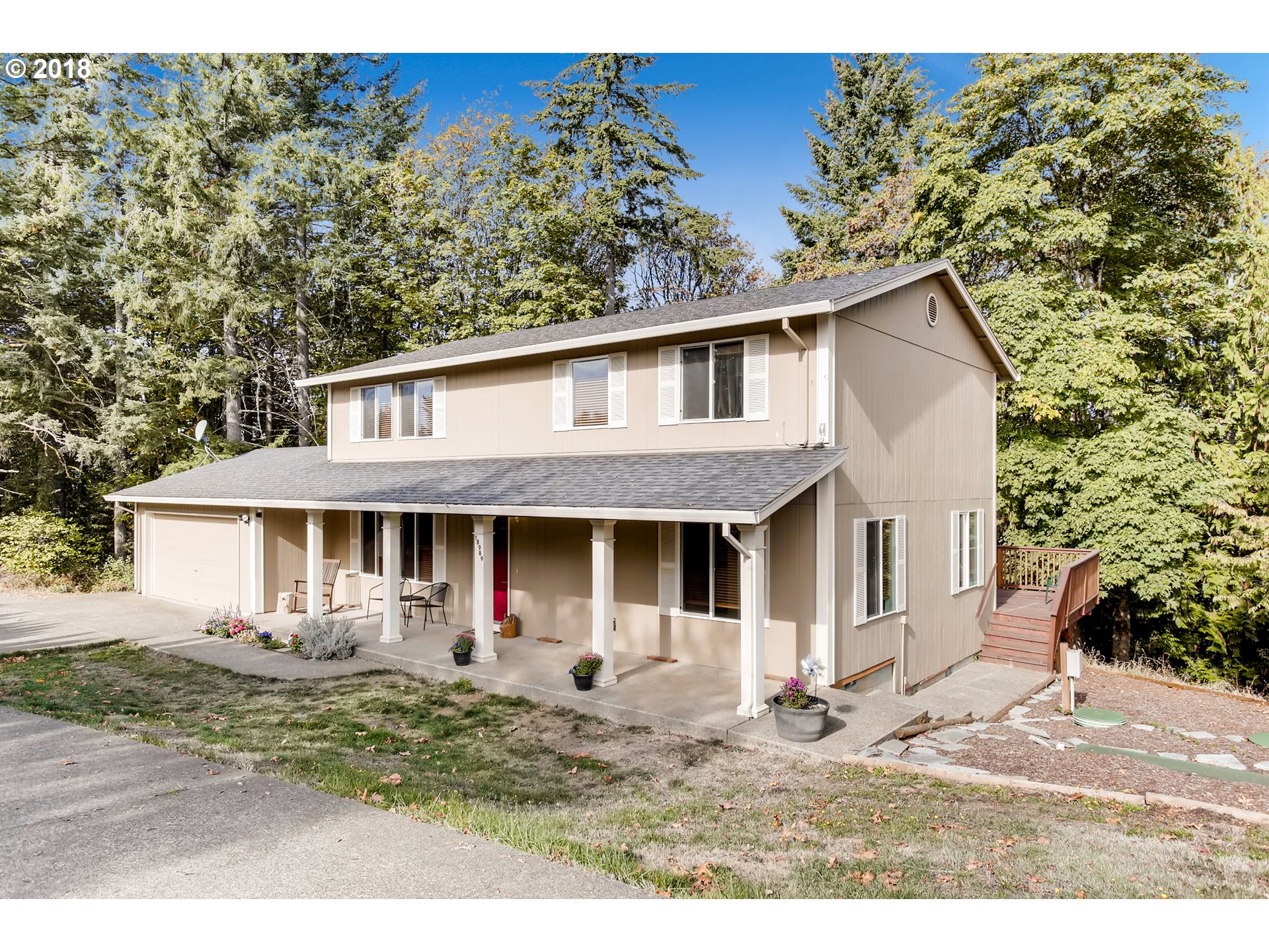 Open house 10/13 12-2! Fall in love with this charming property on Pumpkin Ridge.Just minutes from the Pumpkin Ridge Golf Course.Updates include laminate flooring downstairs, newer water heater, carpet and exterior paint. All bedrooms are upstairs. 4th bedroom could be a bonus room. Huge outdoor deck with amazing views of the trees, .34 lot and RV parking. Beautiful country setting yet close to highway access.