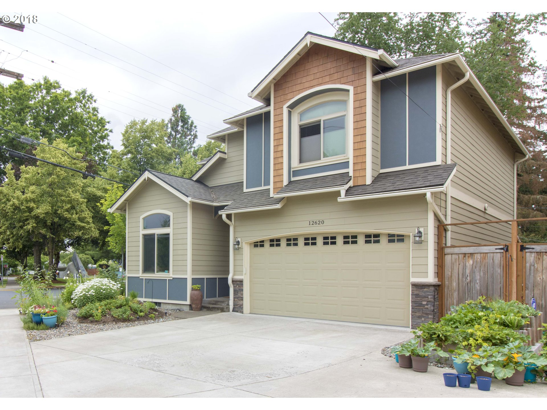 Beautiful almost new Craftsman in coveted Old Town Beaverton-Walk to Farmers Market-Library-Shops-Restaurants-Max! House is gorgeous! High ceilings-Hardwood floors-Open floor plan w/Great Room & private back yard! Kitchen has gas range-Stainless appliances-Pantry-Slab granite-Eat bar-Open to living-dining. Large living dining area  w/slider to patio + yard.Sunny & bright Den off entry! Master suite is huge! Beautifully landscaped yard!