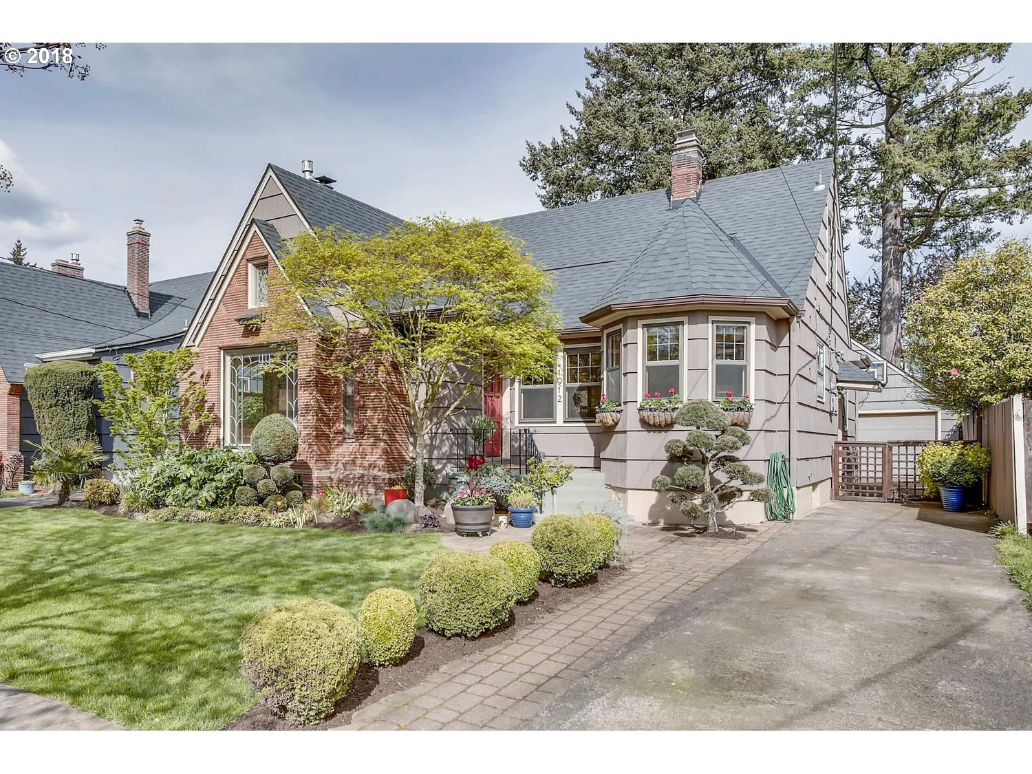 Heart of Rose City neighborhood!  Charming English with all the goodies intact. Beautiful hdwds, leaded glass windows, mahogany woodwork doors and accents! Colorful kitchen with updates and breakfast nook open to formal dining room and living rm w/gas fplc. Finished bsmt with fam.rm and gas fplc. Main floor den/office/bdrm w/french doors to deck and lovely yd Cov'd patio w/wood fplc  Mstr suite up/remod. bath and oak floors. Hurry!