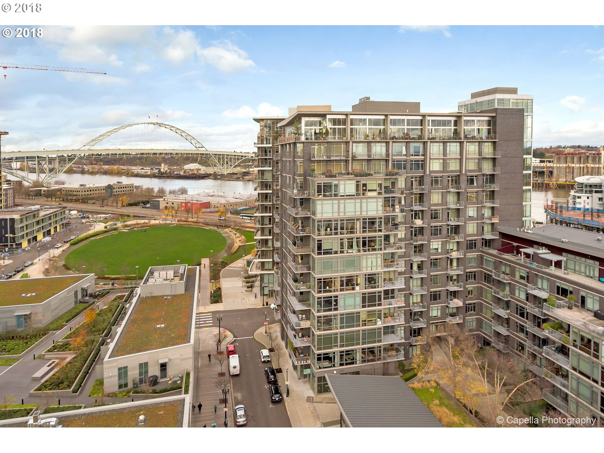 Versatile Pinnacle two story condo in a prime location that can be residential or business or both.High ceilings,great light,modern flair.adaptable floor plan and entries on both levels.Floor to ceiling windows with french doors and built ins upstairs.Sale includes one parking and one storage unit.Unit can be rental if new owner chooses as whole or in 2 parts and for as little as 7 days.