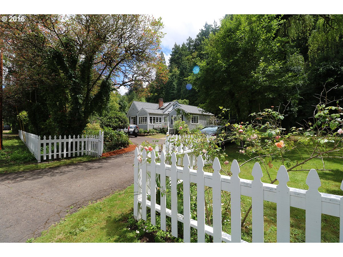 Clackamas River frontage! Awesome historic home on 1.3 acres including a beach on the river, a forest on the hill above & lots of usable level land w/patio-deck-studio-pool & basement! All character & charm intact-yet remodeled thruout! Large sunroom off living-Large kitchen-2 beautiful bathrooms.Lots of big windows & french doors-Huge yard-sunny space,forest behind house on hill & 170FT Clackamas River frontage-access to beach w/trail.