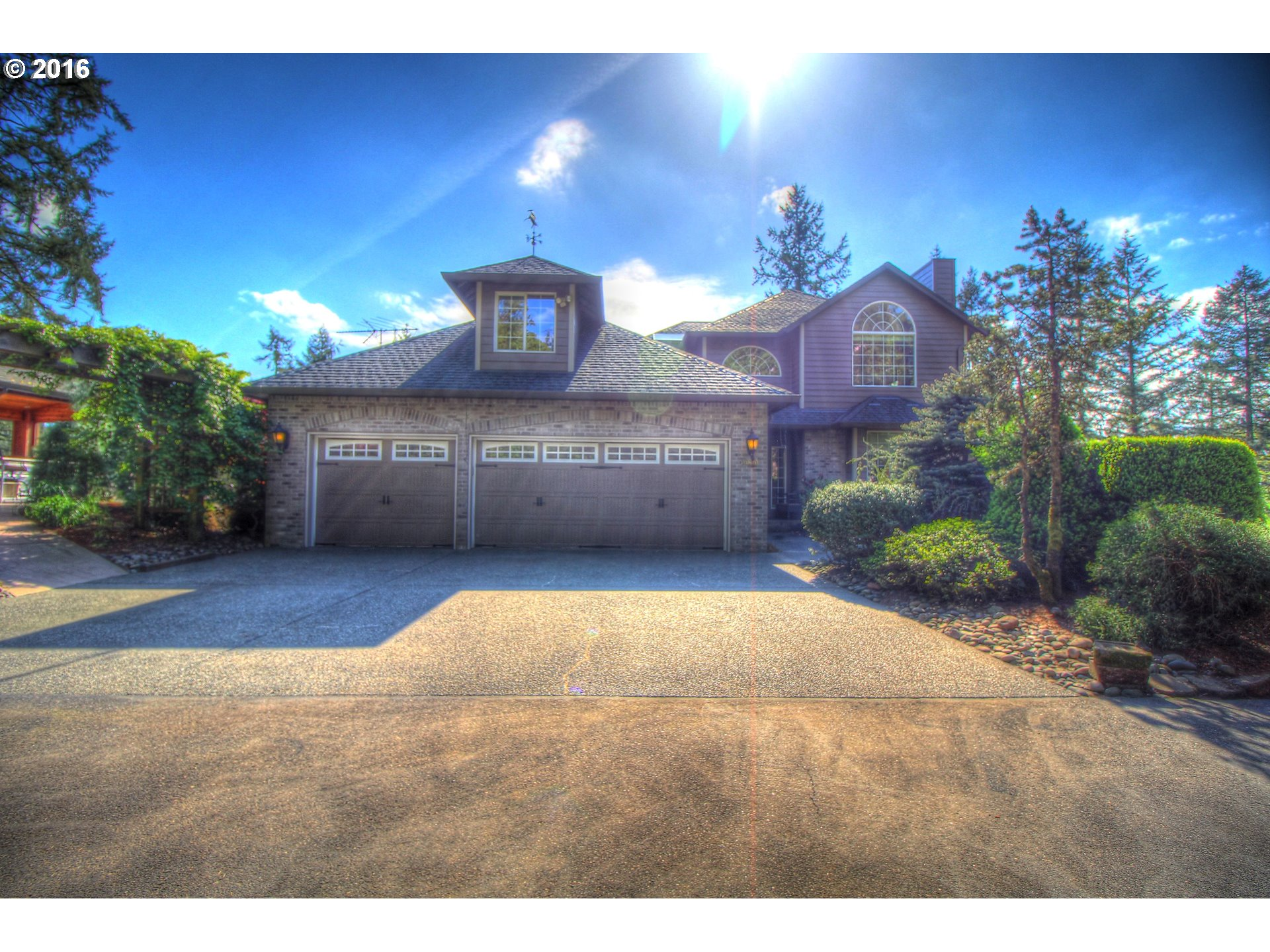 """You'll love the Paradise Point Lewis River frontage and view from this large custom home. Cooks kitchen featuring huge island, new $11k GE Monogram 48"""" gas range, commercial wok, SubZero refrigerator and more. Master suite has gas fireplace and large sitting area. Two family rooms plus a bonus room. All this and more on 5 beautiful acres. The outdoor kitchen is as stunning as the indoor kitchen! Entertain all year round inside and out."""
