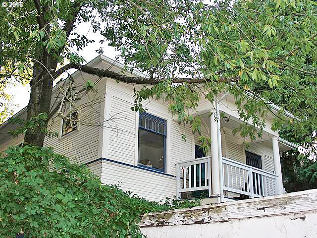 Awesome location, close in Sullivan's Gulch Neighborhood. House sits on tree lined street, walk to MAX, and Broadway Restaurants, cafes and shops.  This is a short sale. Fixer-House is a mess, it needs to be cleaned up, but bones are still good.  Must have cash. First photos show the house 4 months ago, last photos show it now.  Windows are boarded up to keep anyone out.