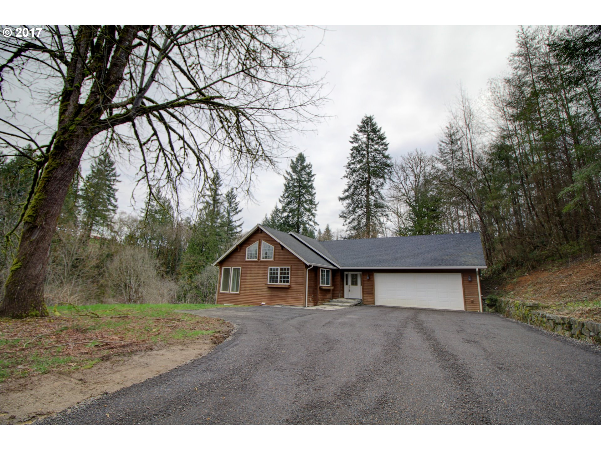 Amazing 11.5 gated, PRIVATE acres with over 3,000 sq ft one level home with new, fully finished daylight basement featuring almost 9' ceilings. Open, bright kitchen with tons of storage. Very large family room up with wood stove and large deck overlooking the acreage and the creek running through. Master on main plus one additional bedroom up. Two large bedrooms down plus extra large bonus room down. So much more to see and love!