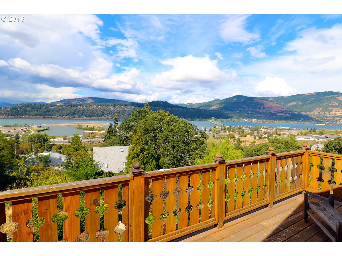 Spectacular 180 degree view of Columbia River & mountains-Watch the wind surfers-walk to downtown.1906 Craftsman home w/charm & character intact-spectacular views from main floor & master! Original wood floors main floor & up-Formal dining room-Sunroom off kitchen-3 remodeled bathrooms-Lot is over half an acre-Possible 8 view condo/townhome lots if house torn down.Seller will divide & sell house $695000 on .25 acres
