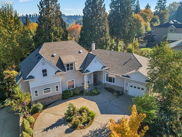 One of a kind custom home. Wonderful floor plan with great flow.Large great room with adjoining gourmet kitchen and sun room.Main floor living with master bedroom,two offices and laundry room on the main floor. Two additional bedrooms upstairs as well as a large bonus room. Ample storage with extra large closets. Exceptional finishes and artistic touches,custom tile,lighting and painting.Private lot. Five car garage.